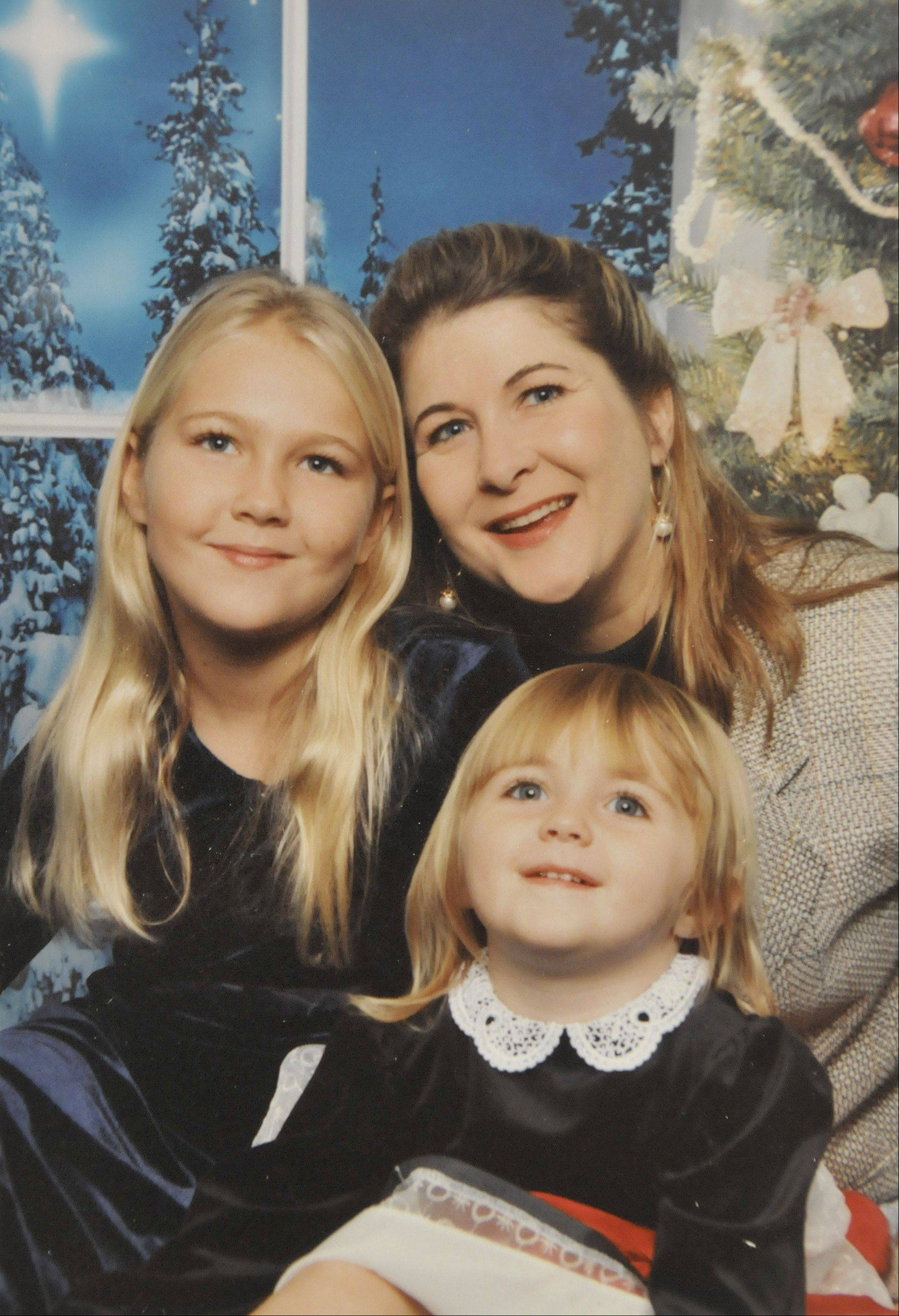 Marci Webber with her daughters Mallory, top left, and Madison in a Christmas 2002 portrait.