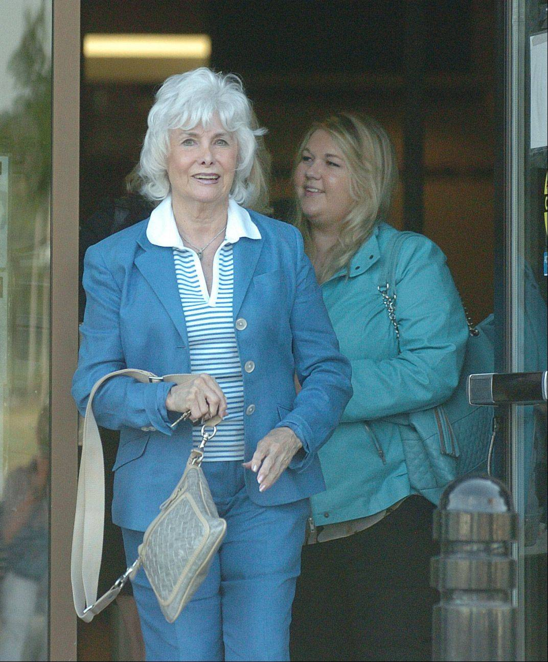 Mallory Webber, right, and her grandmother, Marjorie Webber, leave the DuPage County Courthouse last week. Mallory's mother, Marci Webber, was found not guilty by reason of insanity for the murder of her 4-year-old daughter in Bloomingdale.