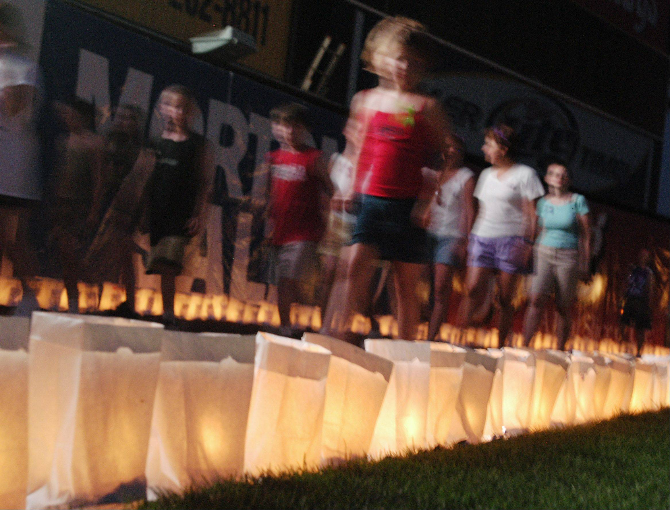 Luminaria line the tracks at Relay For Life events to honor those touched by cancer and to remember those who've died of the disease. Often, a memorial lap is walked in silence.