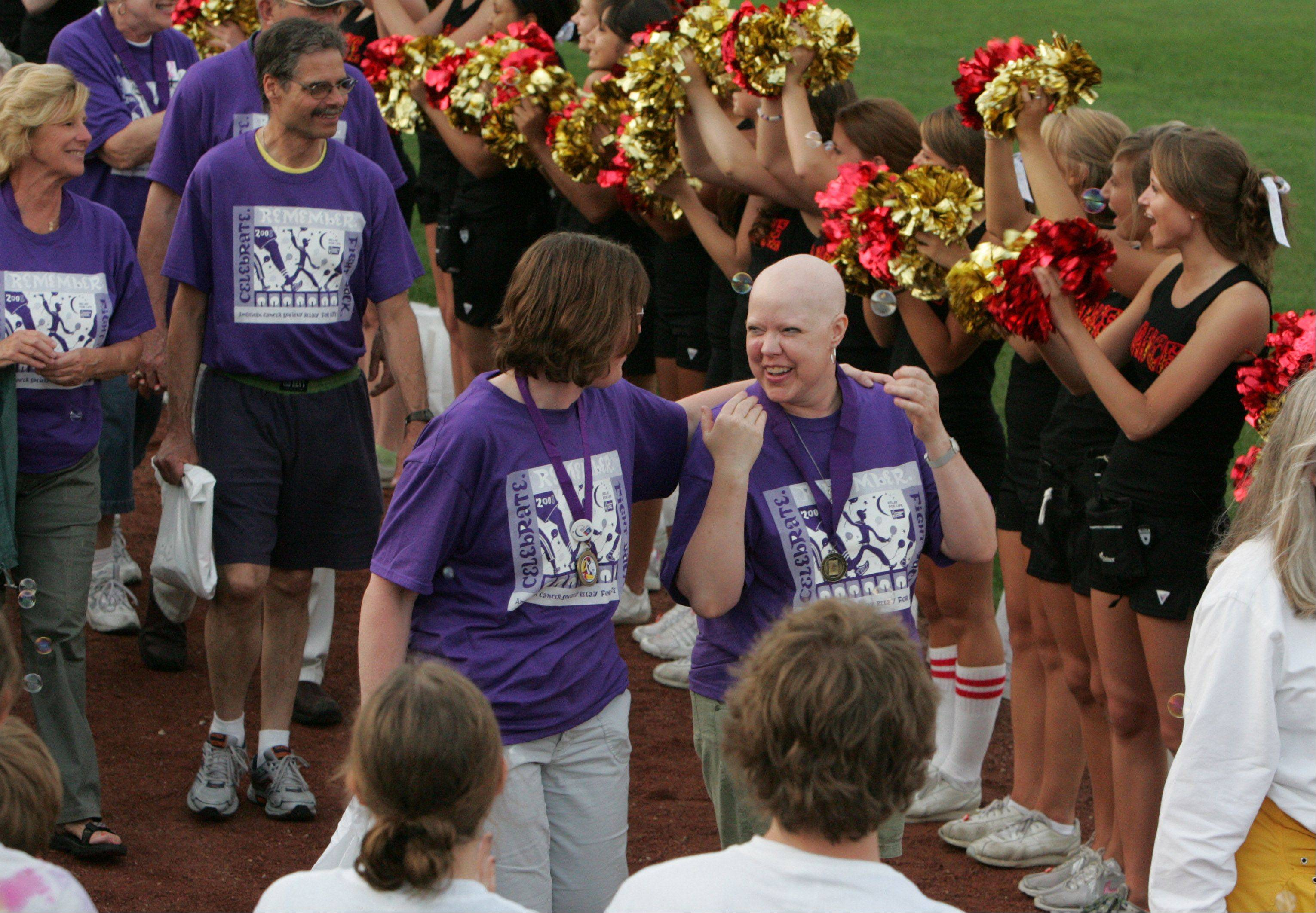 The first lap of a Relay For Life is a Survivors Lap, celebrating victories large and small over cancer. Survivors often are followed by caregivers.