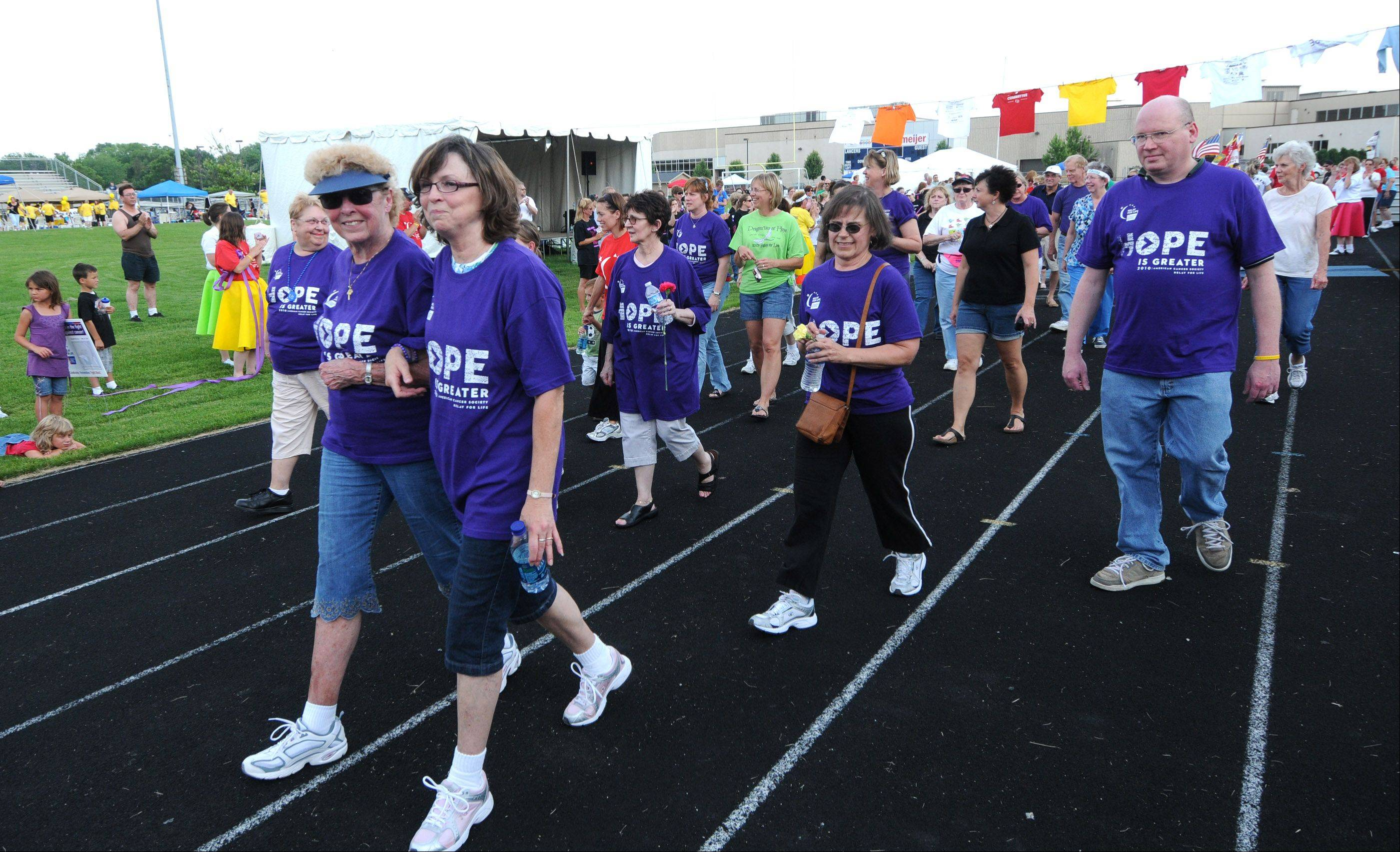 Following the Survivors Lap, members of each relay team take turns walking through the night to symbolize that the fight against cancer doesn't rest.