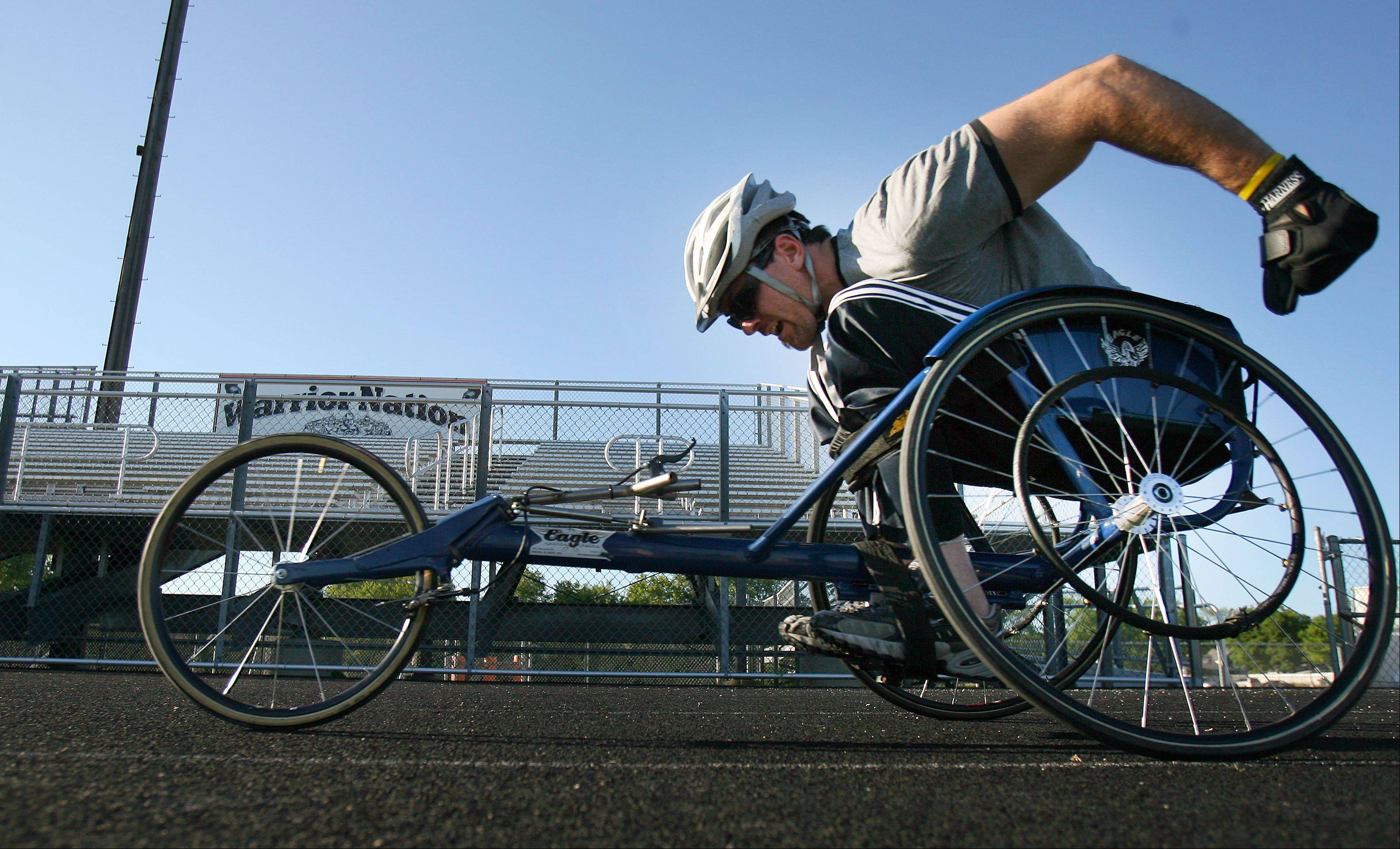 "Bob Swanson of Round Lake competes in the 800 meter wheelchair race during the 5th annual paralympic ""Run and Roll"" at McCracken Field in McHenry Wednesday."