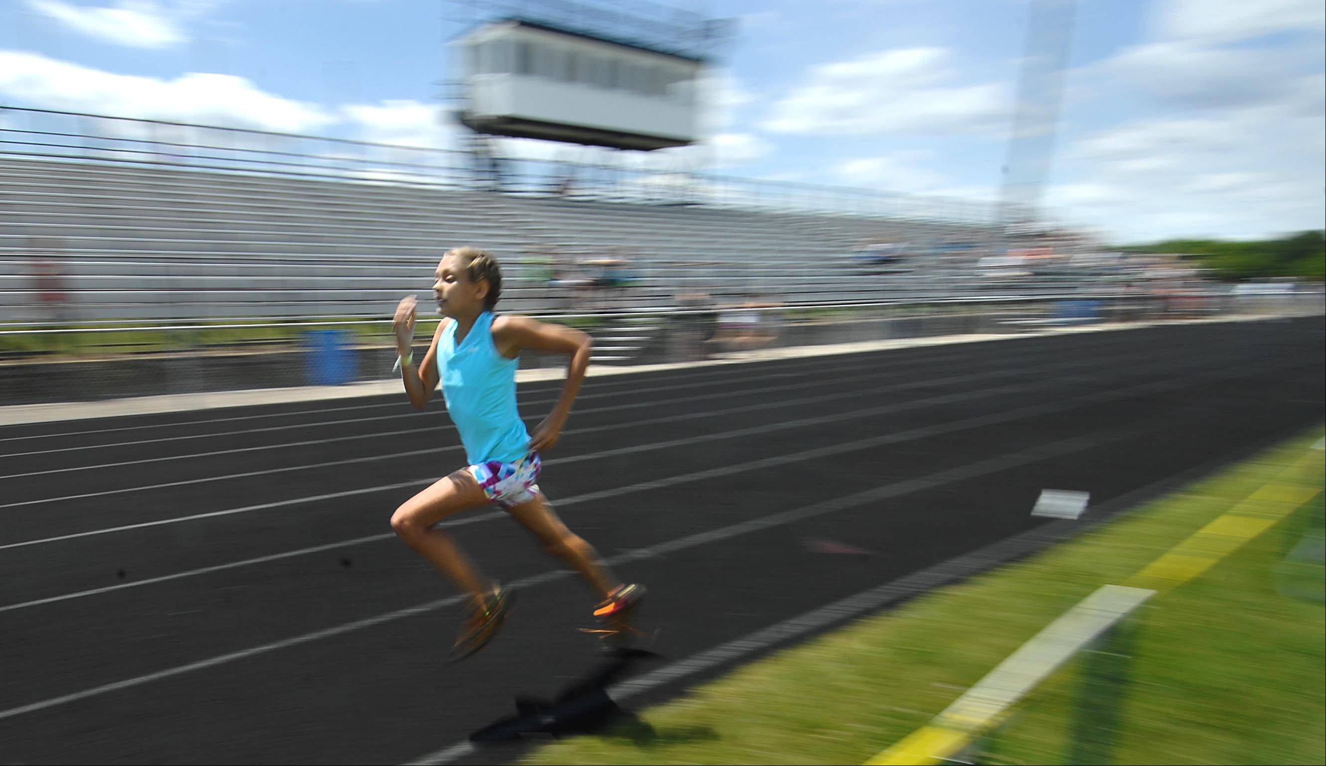 Chloe Smith, 12, of Lake in the Hills, wins the 800-meter run Sunday at the Hershey National Track and Field Games at Cary-Grove High School. The Cary Park District and Hershey ran the event, which was open to all 9-14-year-olds. Winners may be able to advance and compete in a national meet later.
