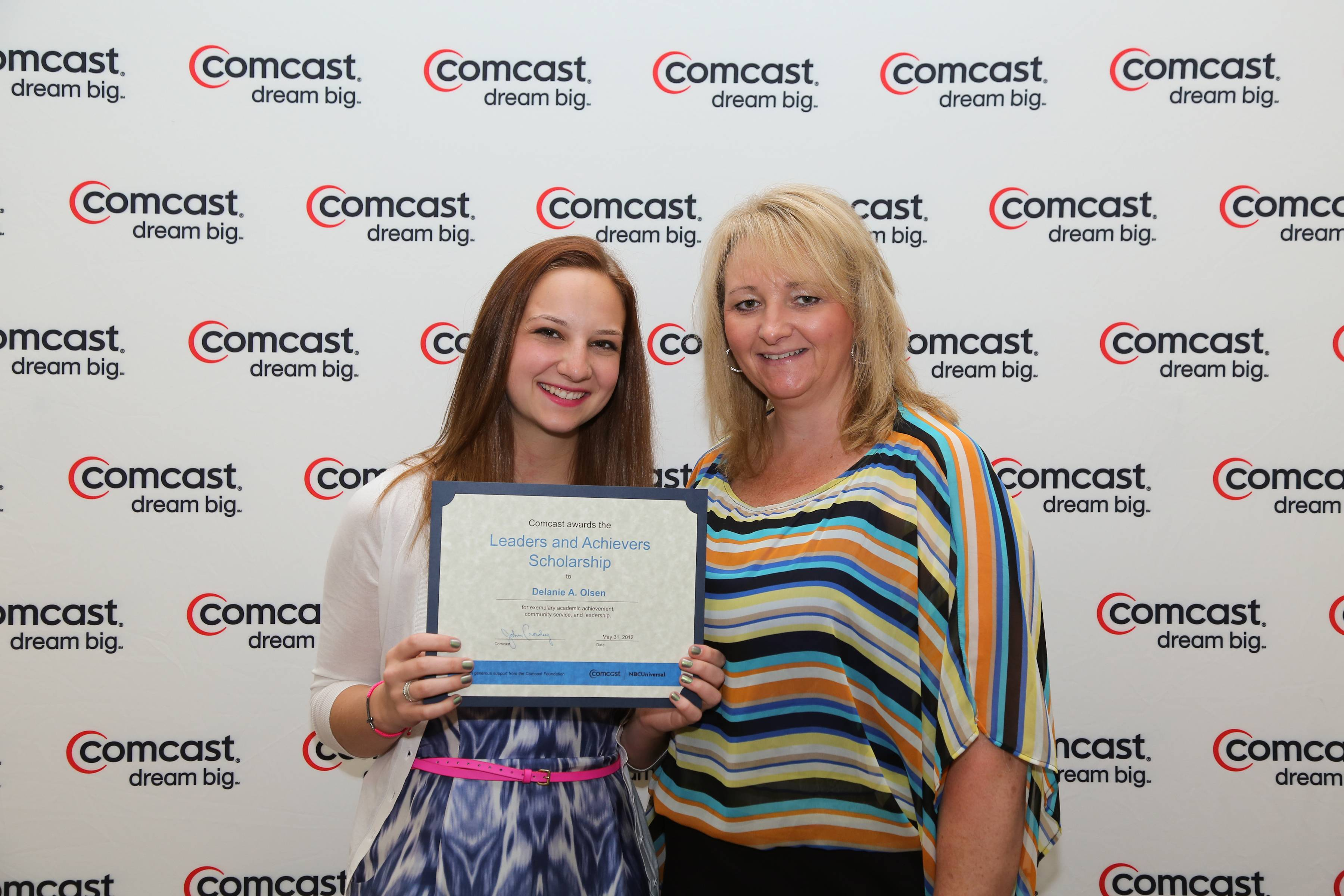 Delanie Olsen accepts a $1,000 Comcast Leaders and Achievers Scholarship