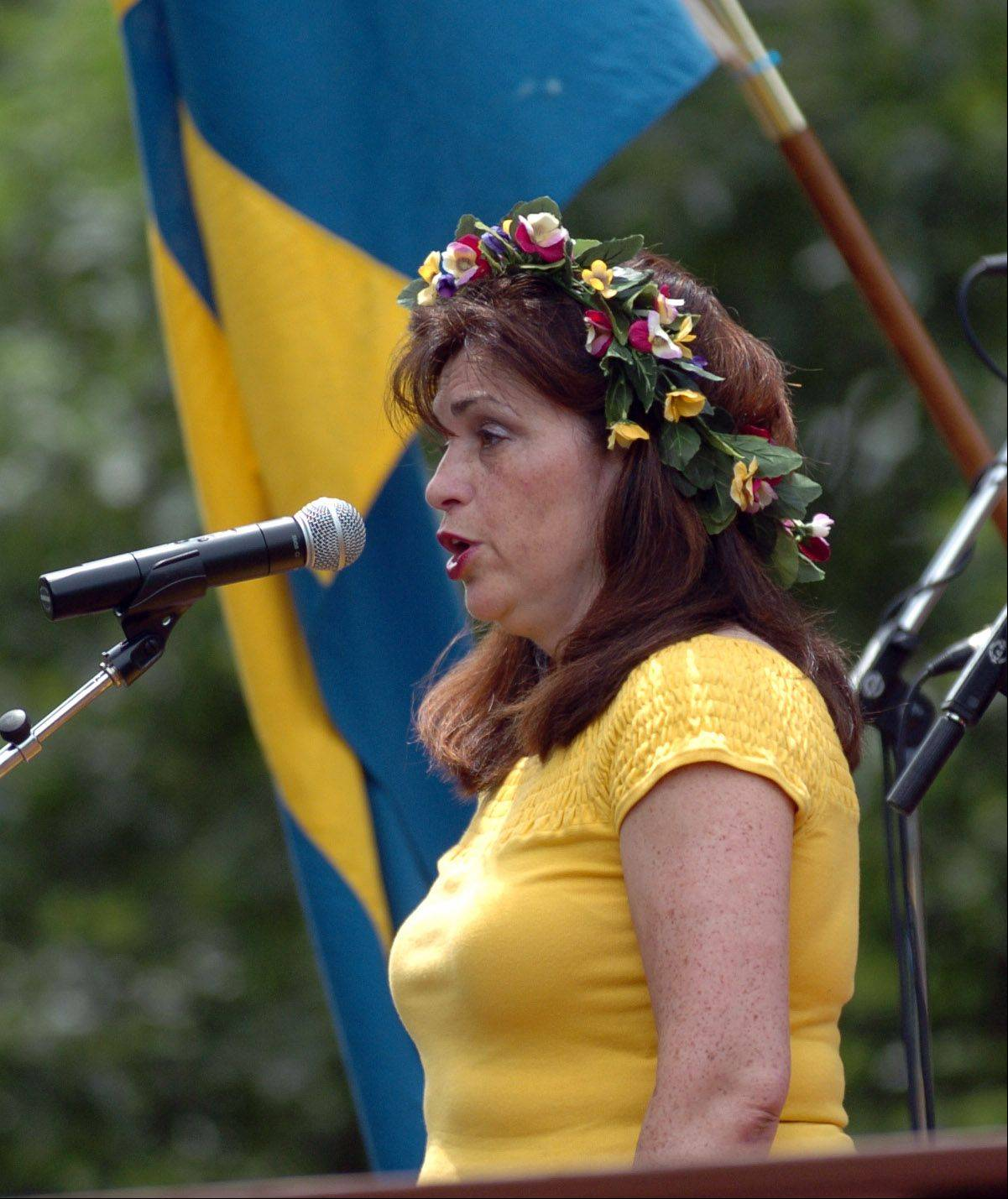 Marguerite Karl sings the American and Swedish national anthems to kick off the opening ceremony at the 100th annual celebration of Swedish Day at Good Templar Park in Geneva.