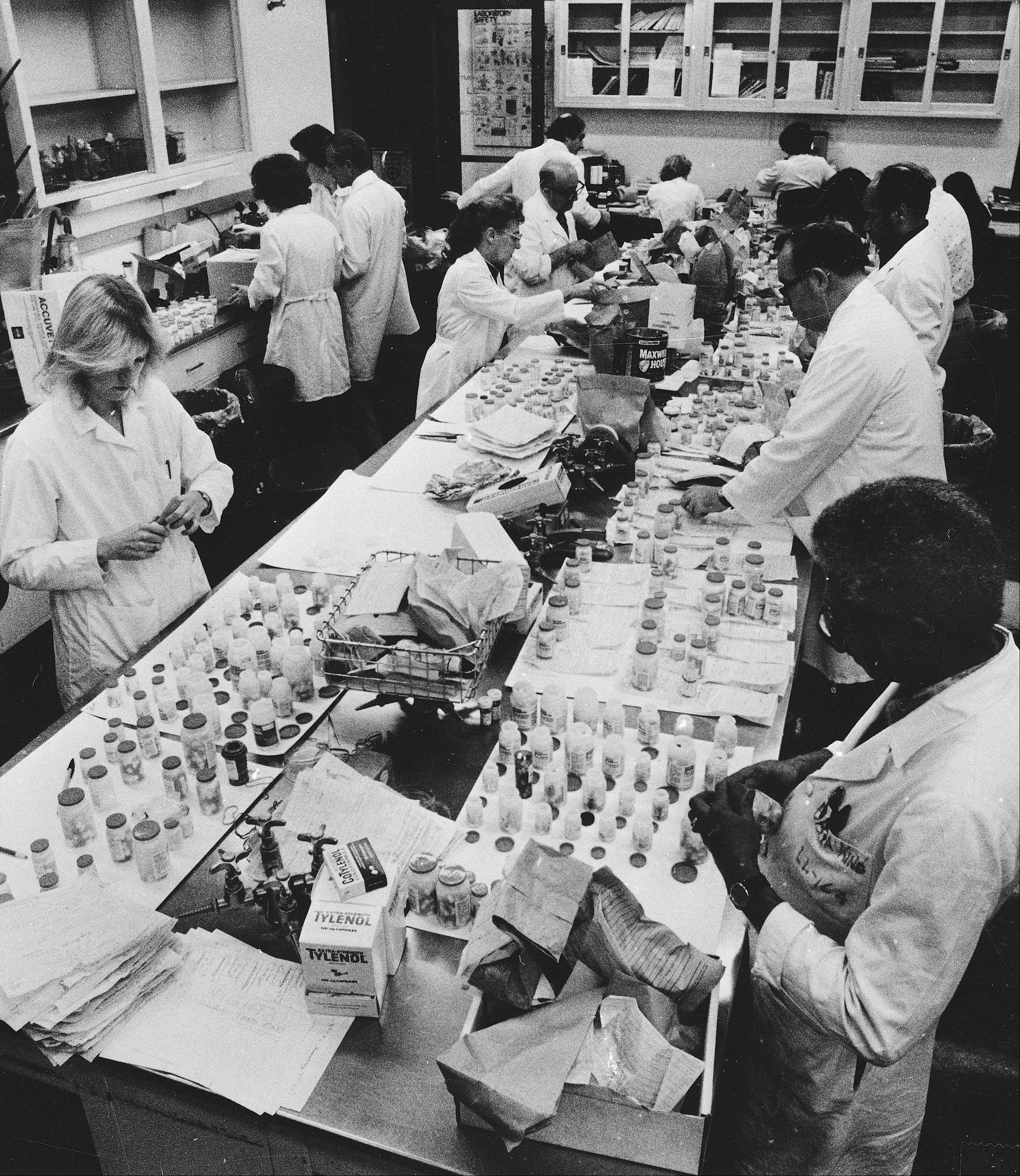 In this Oct. 7, 1982, file photo, employees of the Chicago City Health Department test Tylenol medication for the presence of deadly cyanide at the department's lab. The Tylenol case involved the use of potassium cyanide and resulted in a mass recall.