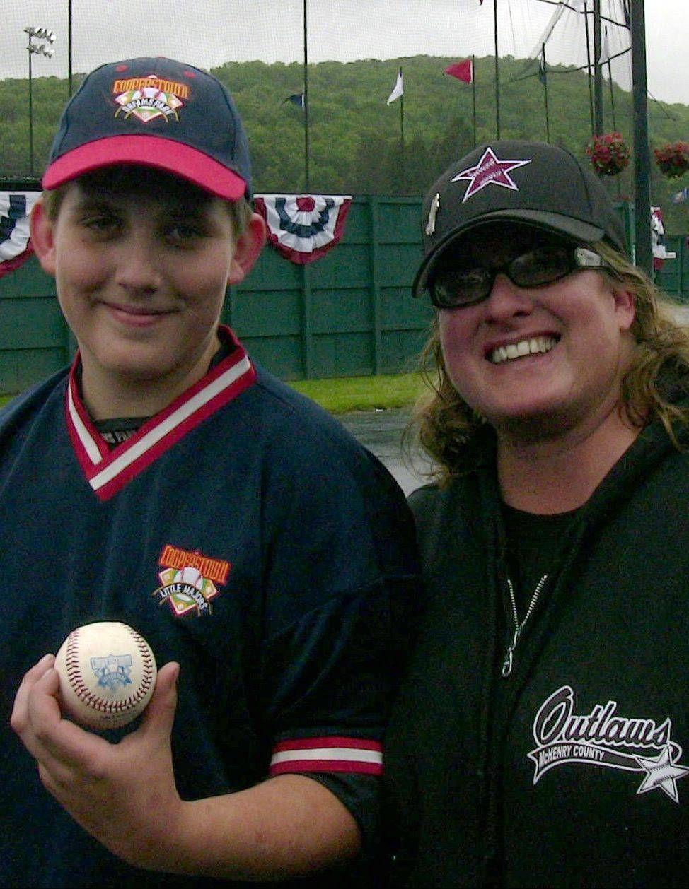 Mason Kamp, 12, of Algonquin with his mom Kathy Dozier and the ball he hit for a grand slam in her honor.