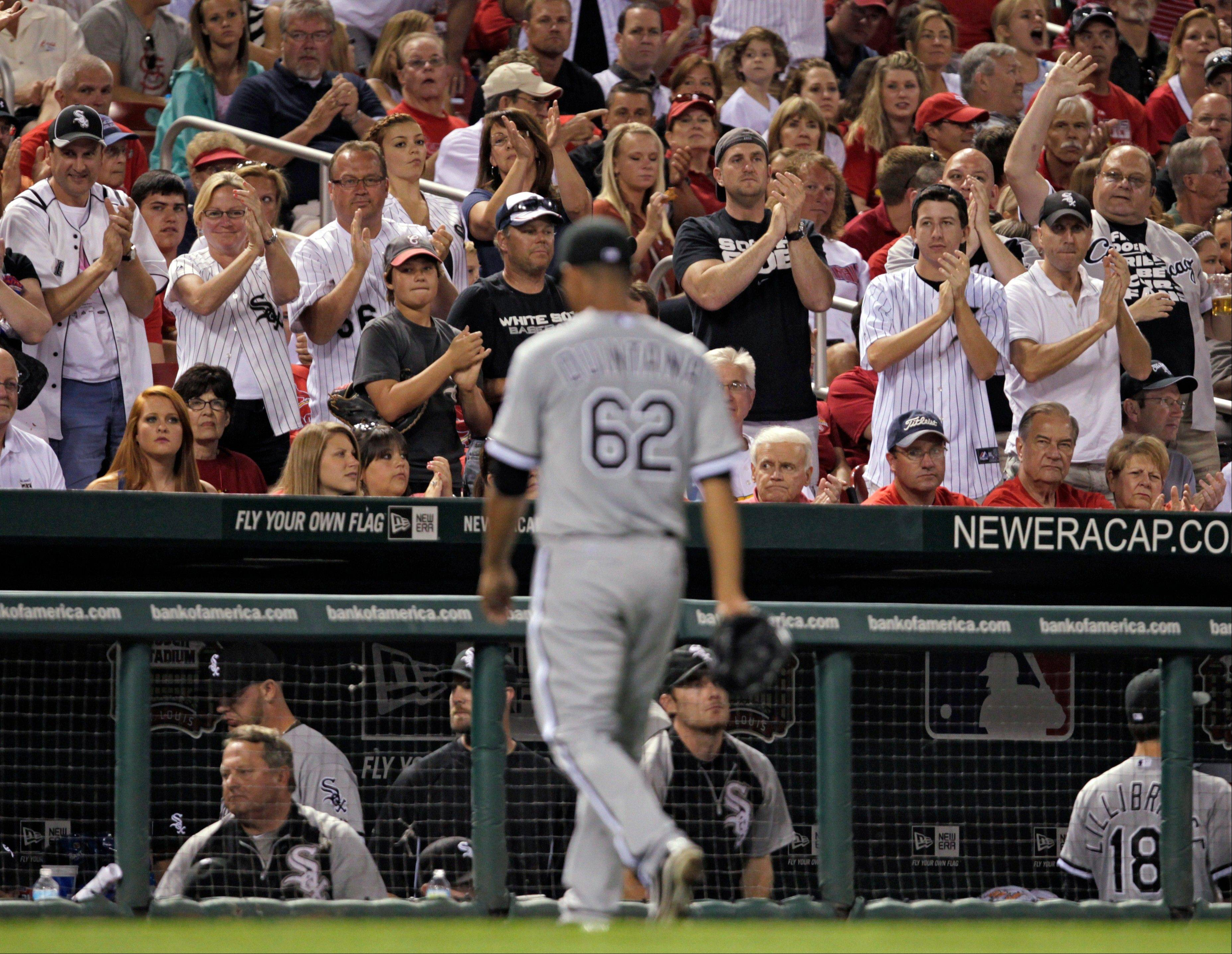 Chicago White Sox fans cheer as White Sox starting pitcher Jose Quintana leaves in the sixth inning Tuesday during a game against the St. Louis Cardinals in St. Louis. Quintana lasted 5 1/3 innings, giving up one run on 10 hits.