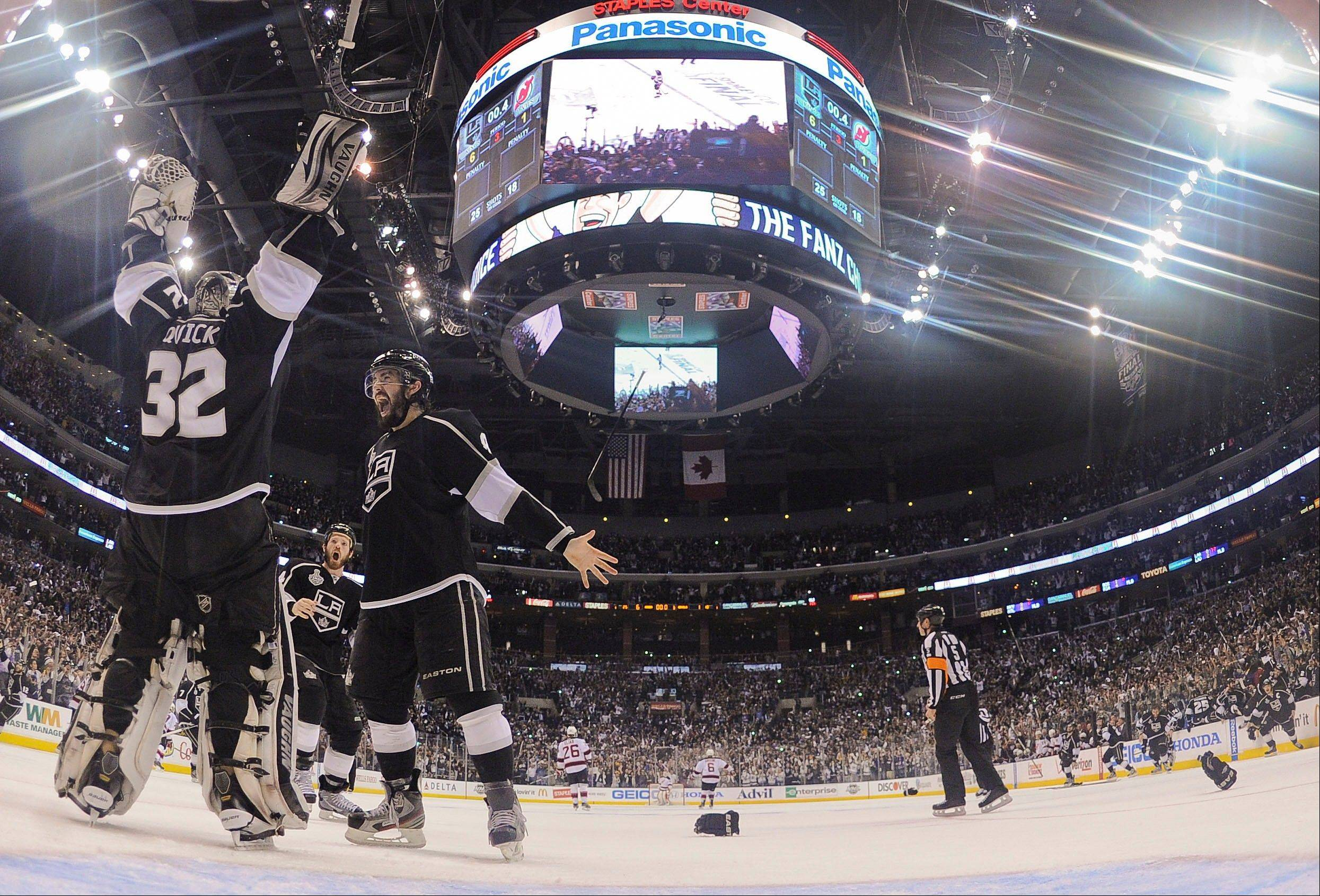 Los Angeles Kings defenseman Drew Doughty (8), Los Angeles Kings center Colin Fraser (24) and Los Angeles Kings goalie Jonathan Quick celebrate after the Kings beat the New Jersey Devils.