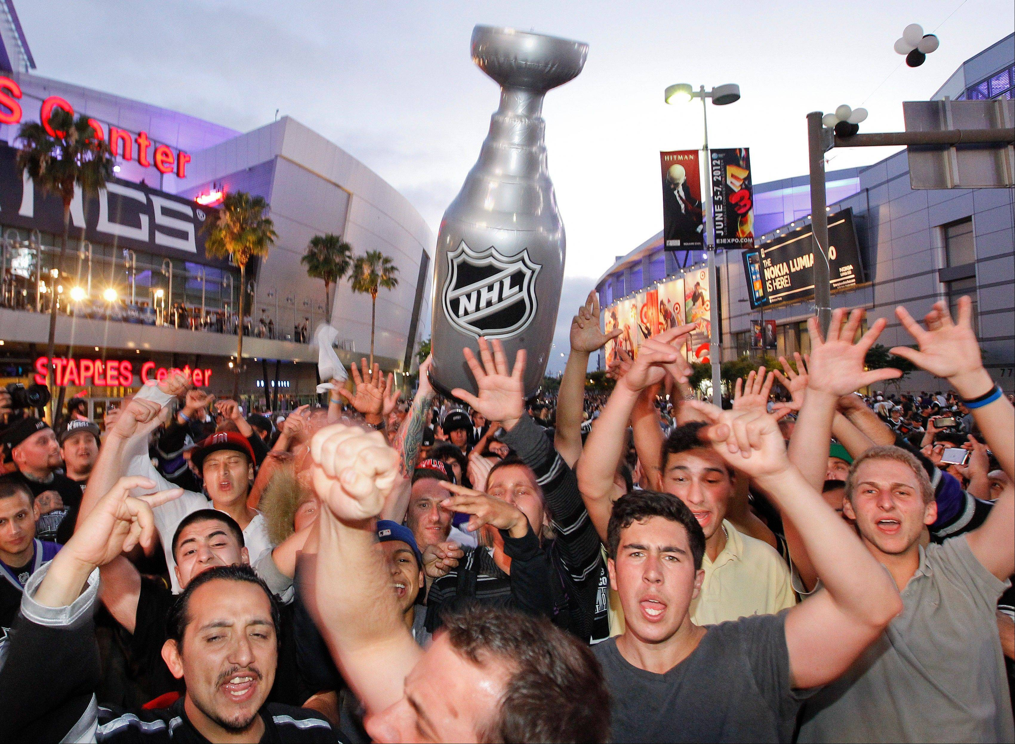 Los Angeles Kings fans celebrate their Stanley Cup victory over the New Jersey Devils outside the Staples Center after Game 6.