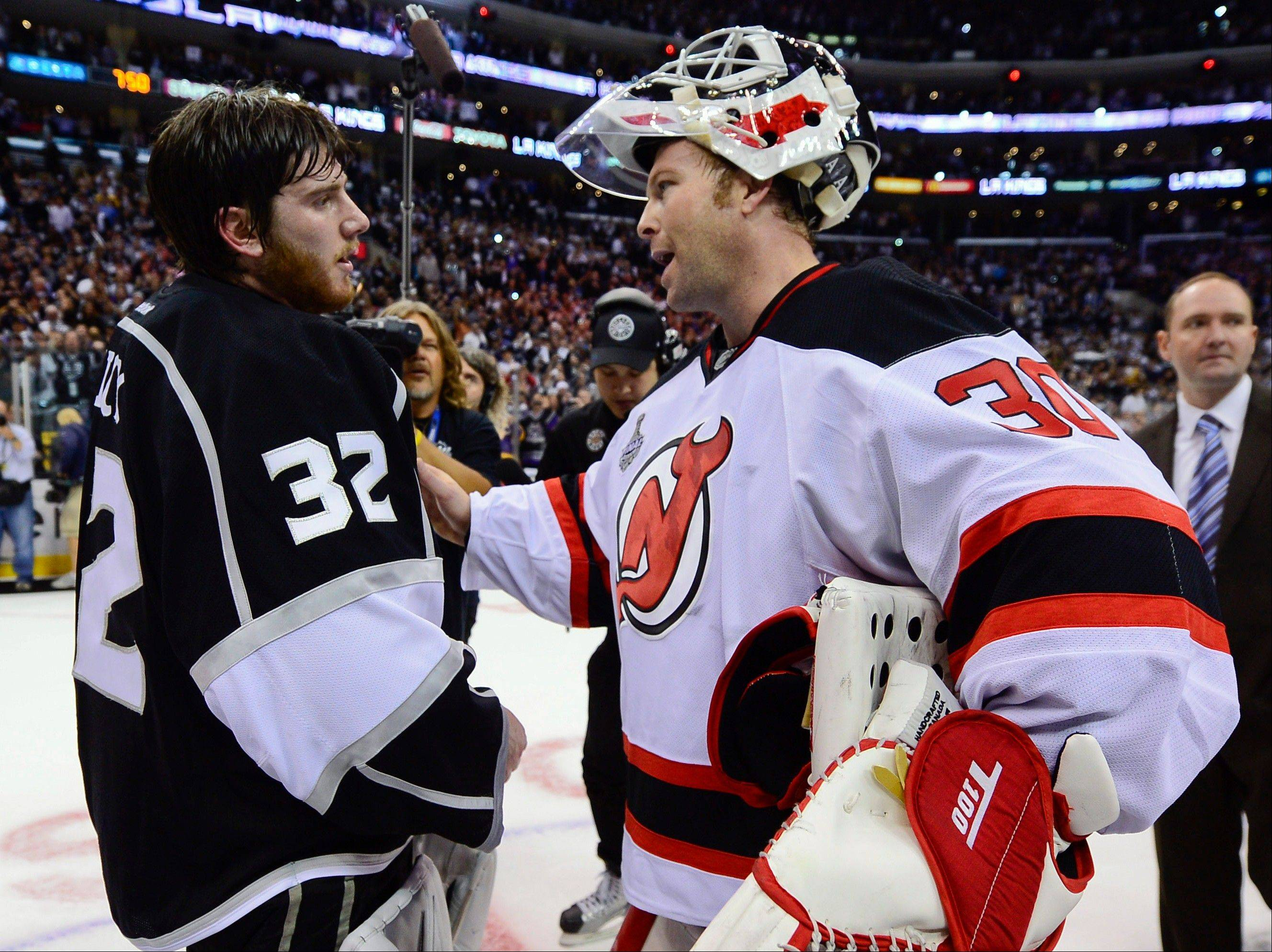 Los Angeles Kings goalie Jonathan Quick, left, is congratulated by New Jersey Devils goalie Martin Brodeur Monday after the Kings defeated the Devils 6-1 to win the Stanley Cup.