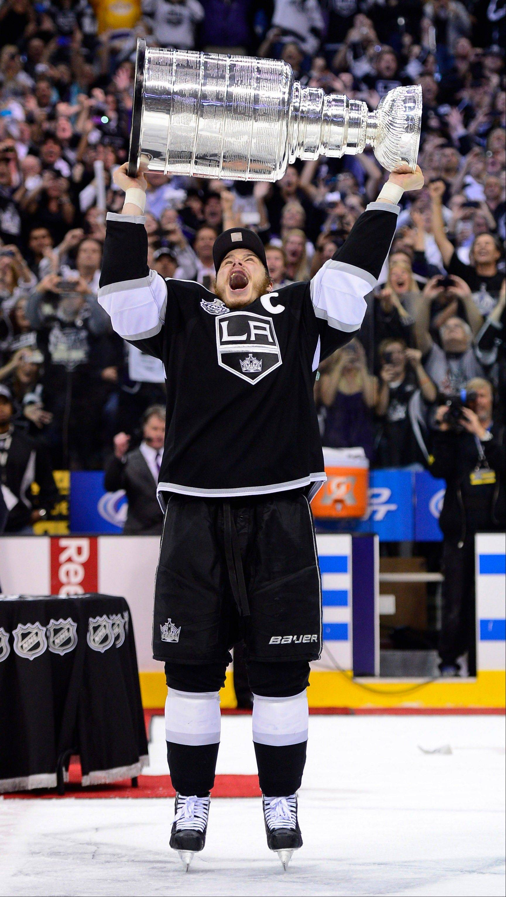 Los Angeles Kings captain Dustin Brown hoists the Stanley Cup Monday after the Kings beat the New Jersey Devils 6-1 during Game 6 of the Stanley Cup Finals.