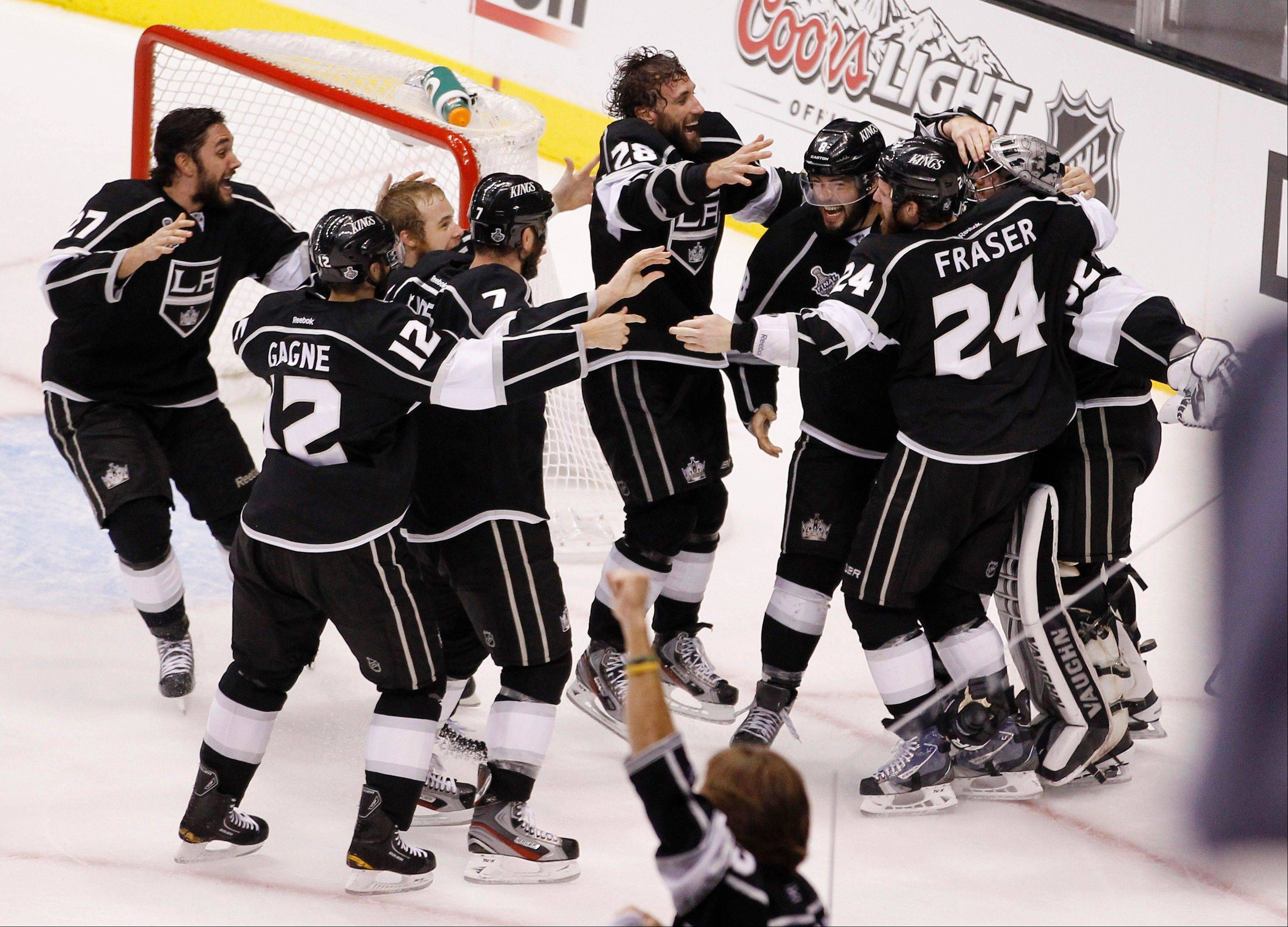 The Los Angeles Kings react as time runs off the clock to beat the New Jersey Devils 6-1 during Game 6 of the Stanley Cup Finals.
