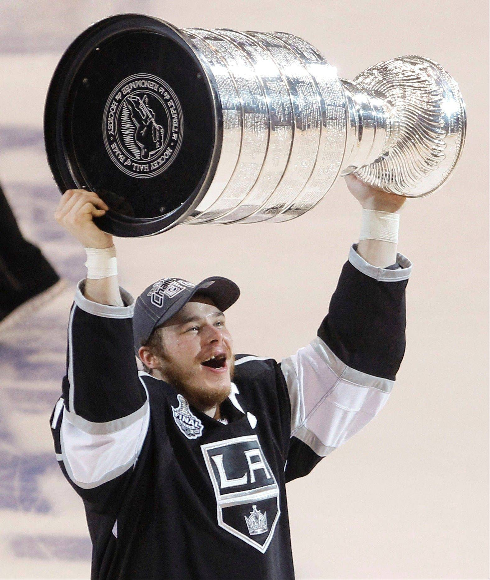 Los Angeles Kings captain Dustin Brown holds up the Stanley Cup Monday after the Kings beat the New Jersey Devils 6-1 during Game 6 of the Stanley Cup Finals.