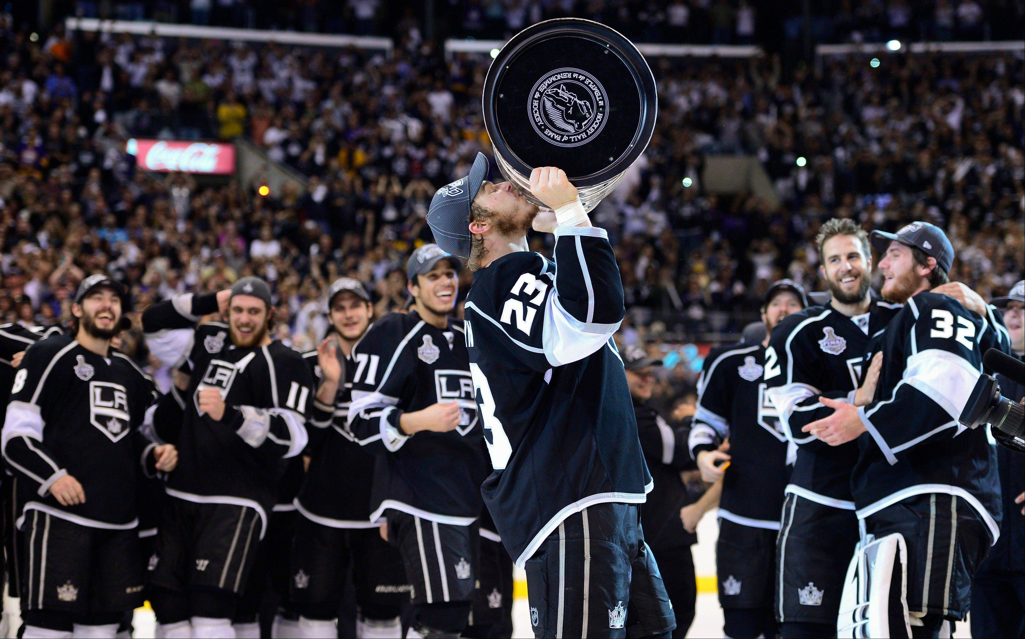 Los Angeles Kings captain Dustin Brown kisses the Stanley Cup Monday after the Kings beat the New Jersey Devils 6-1.