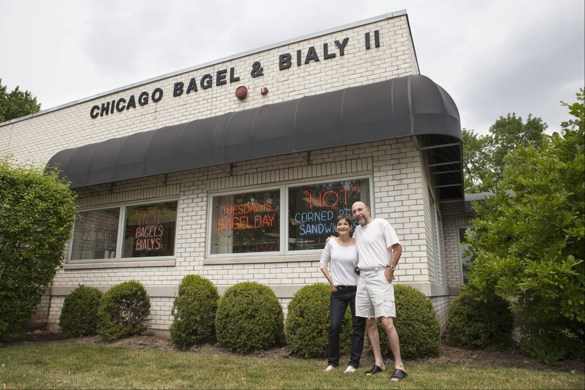 Harold and Sharon Harkavy, owners of Chicago Bagel and Bialy, pose for a portrait outside their Wheeling business turns 30 in July.
