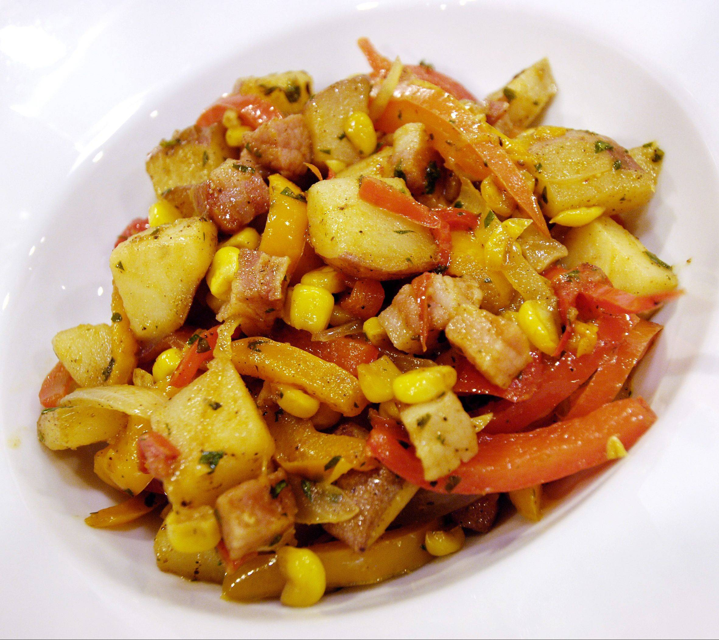 Fresh corn goes into a saute with potatoes, pepper and pancetta; chef Kelly Sears's recipe pairs well with a variety of summer fare.