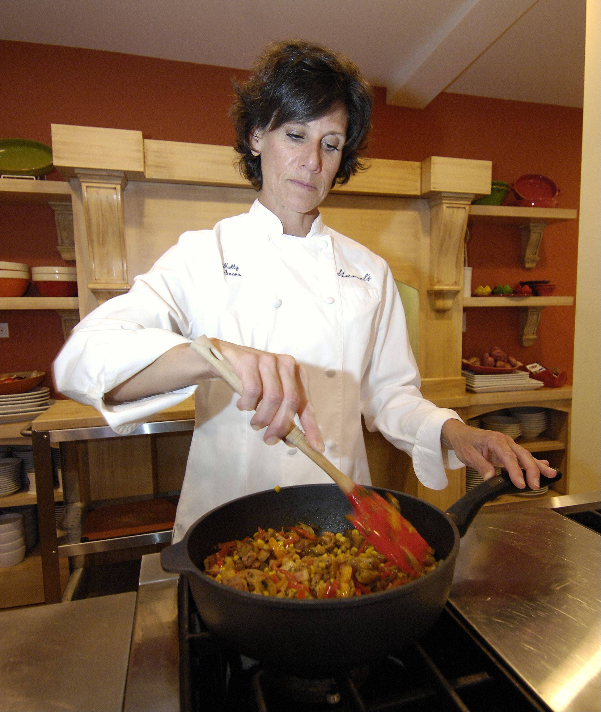 Chef Kelly Sears makes Corn Sauté with Pancetta, Potatoes and Peppers in the kitchen at Marcel's Culinary Experience in Glen Ellyn where she coordinates the store's cooking classes.