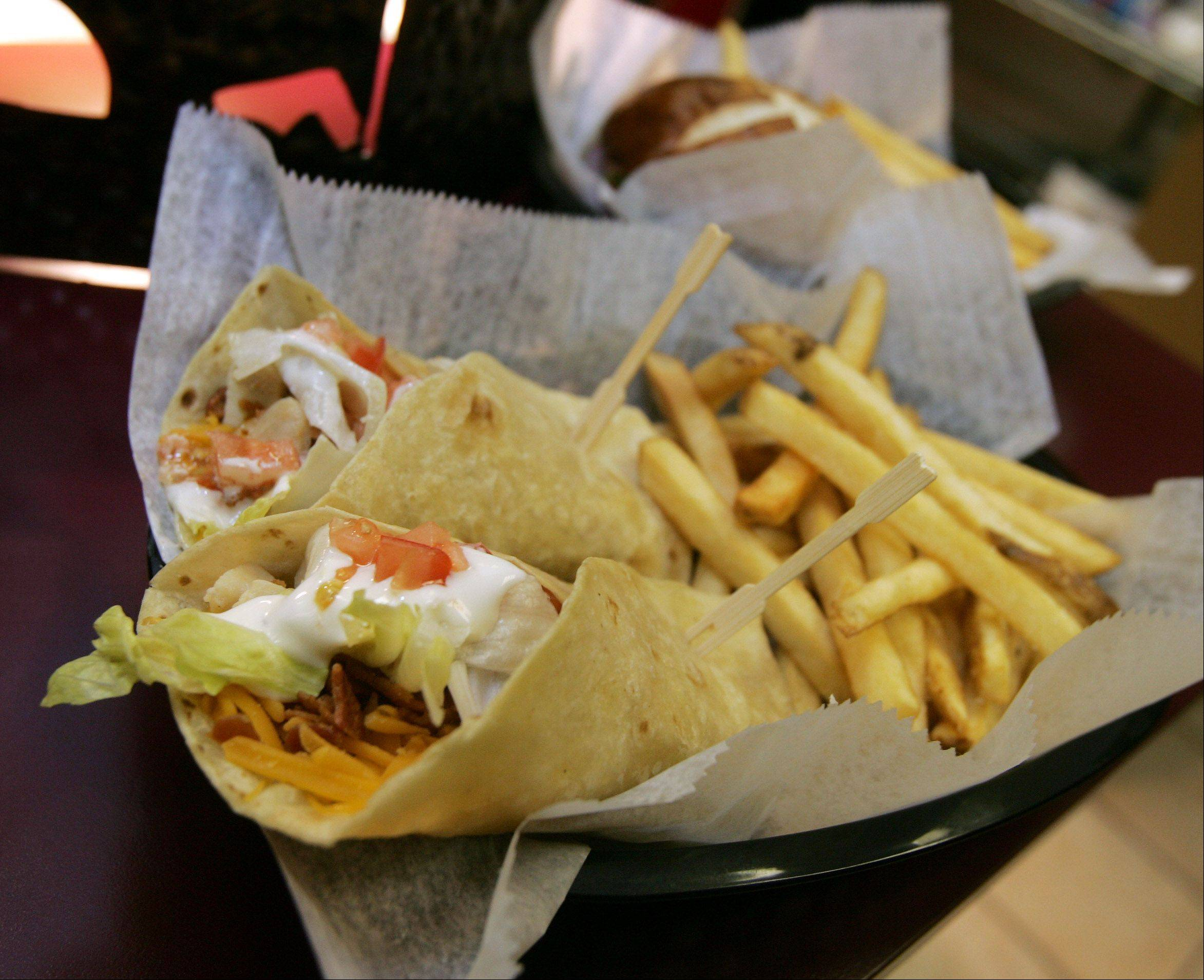 The chicken bacon wrap with fries is one of the dinner options at Mavericks.