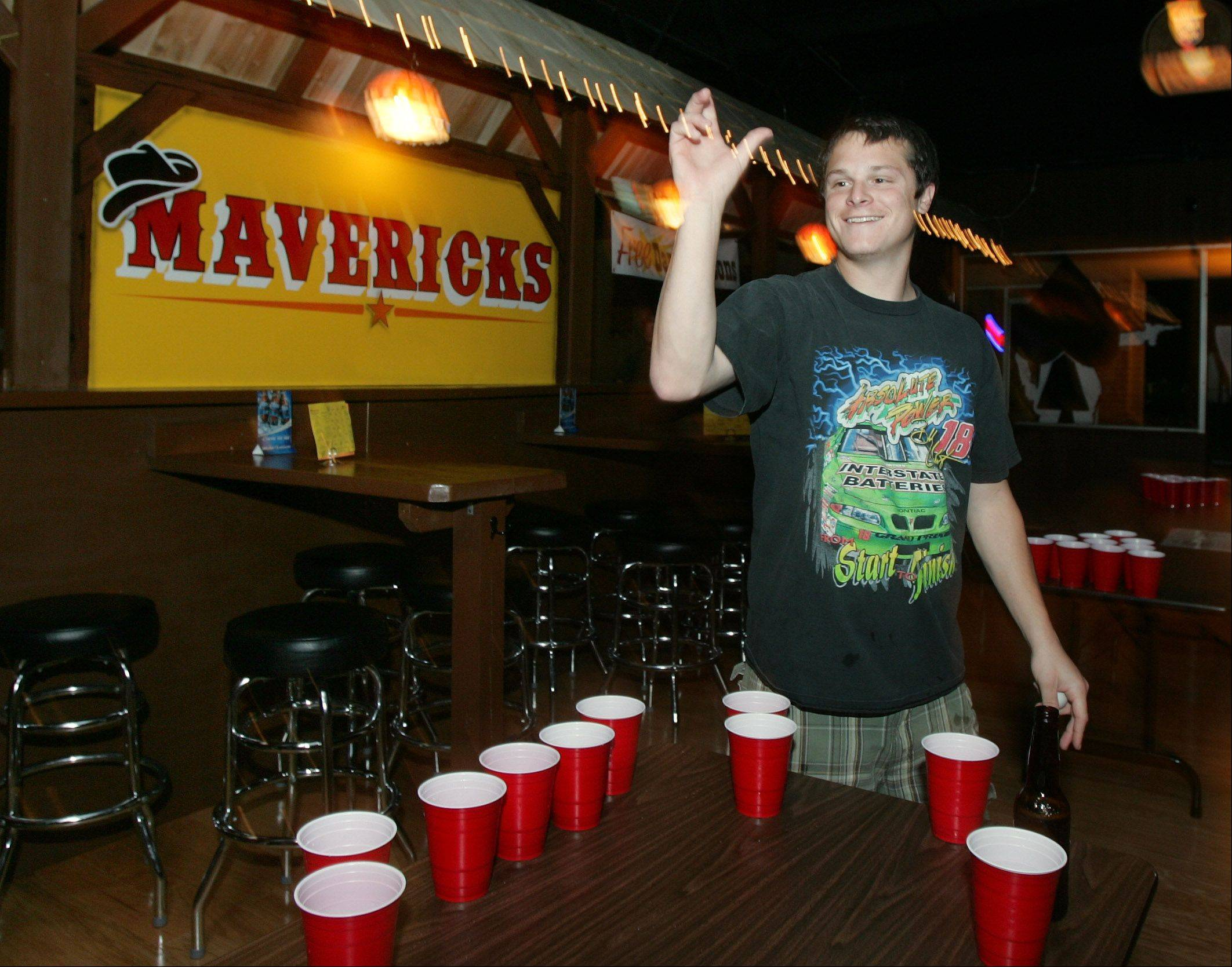 David Nelson of Libertyville plays water pong at Mavericks.