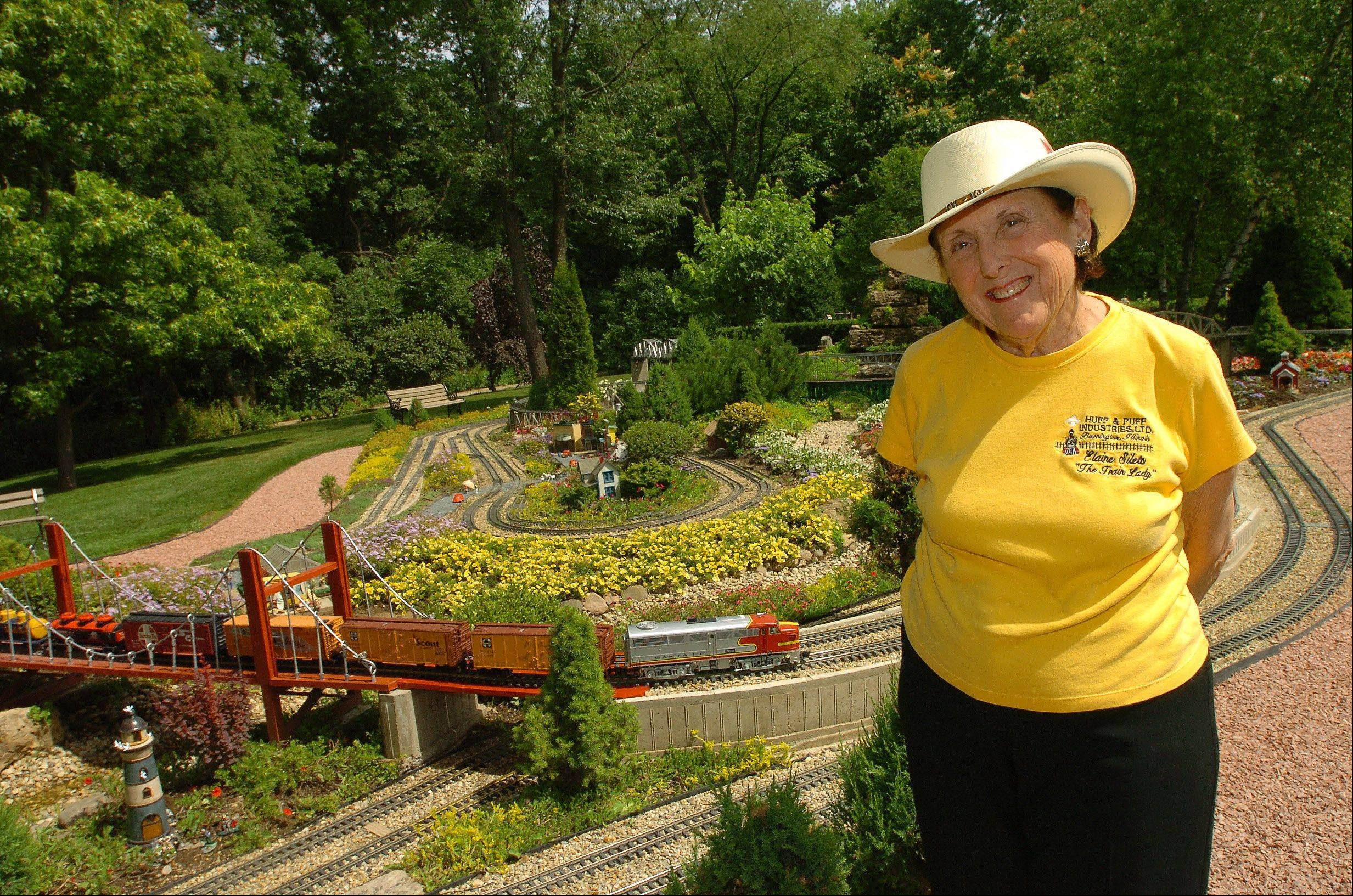 """Train Lady"" Elaine Silets and her private model railroad gardens and museum will be open to the public June 23. The rare public showing is a fundraiser for a scholarship fund created in honor of Silets' late husband, attorney Harvey M. Silets."