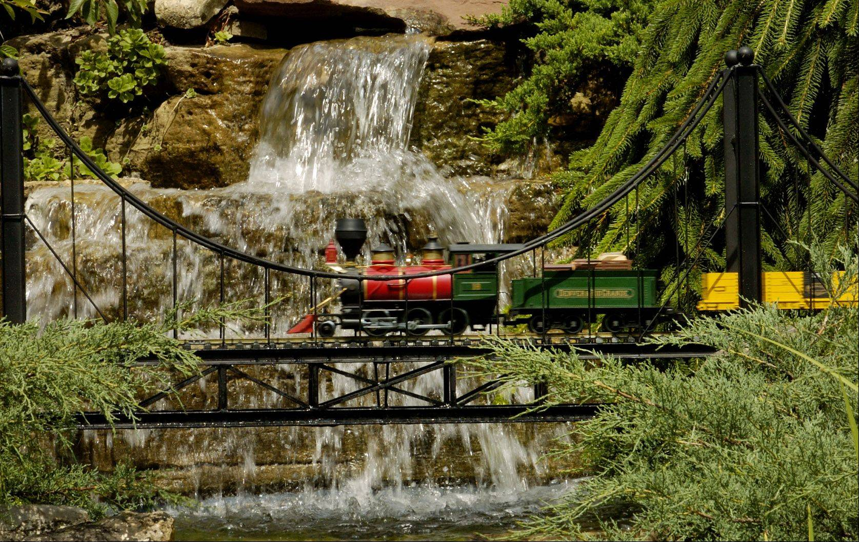 """Train Lady"" Elaine Silets's Japanese garden railway will be open to the public June 23. The rare public showing is a fundraiser for a scholarship fund created in honor of Silets' late husband, attorney Harvey M. Silets."