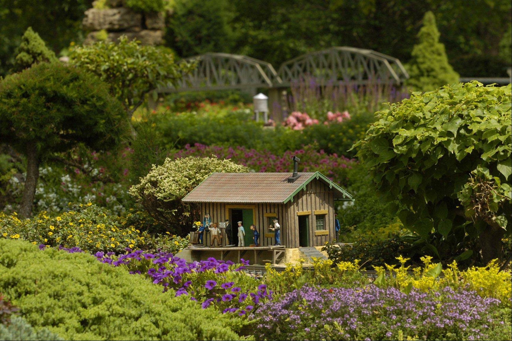 "This is one of the scenes along ""Train Lady"" Elaine Silets's private model railroad and garden railways. The gardens will be open to the public Saturday as part of a fundraiser for a scholarship fund created in honor of Silets' late husband, attorney Harvey M. Silets."