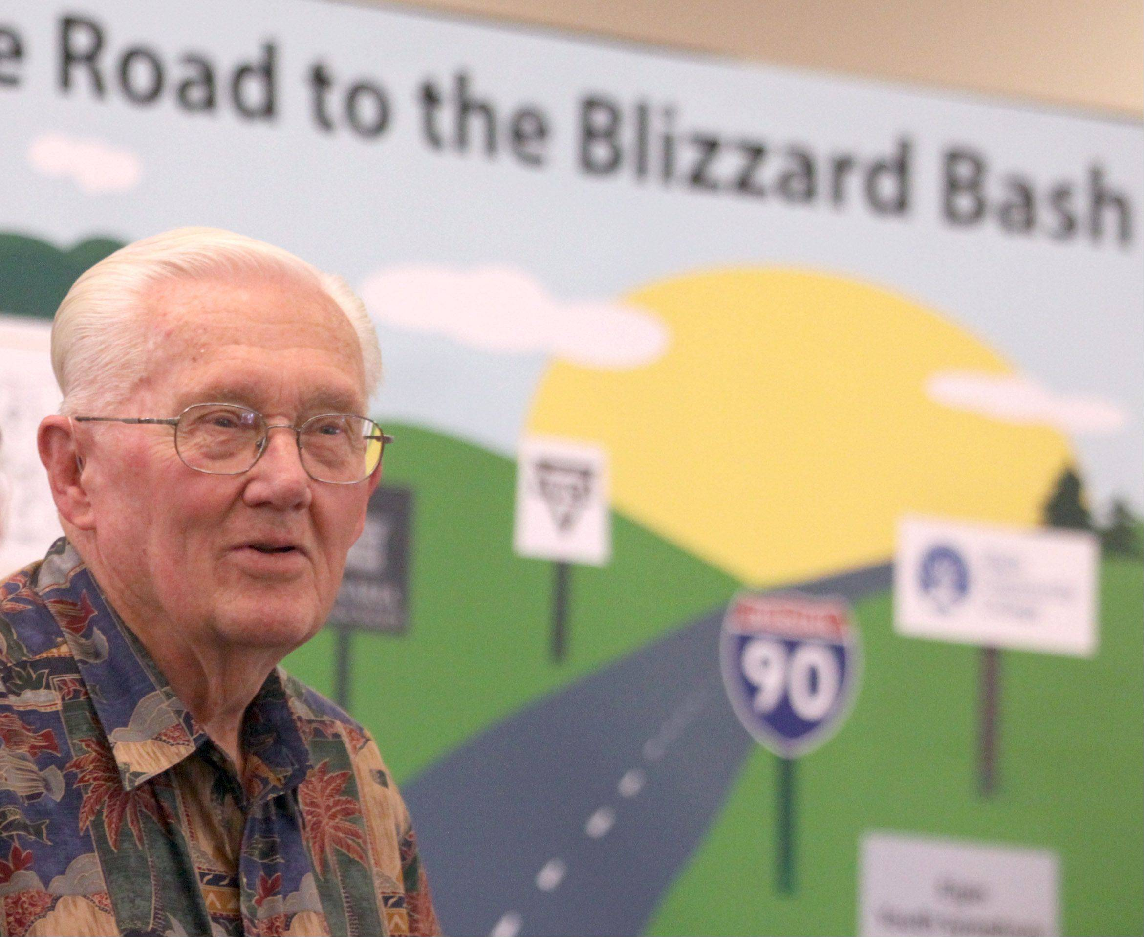"Harry Blizzard watches as participants take part in a ""Blizzard Bee"" in the lobby of the Gail Borden Public Library in Elgin. The event of trivia on Blizzard's life was arranged to honor Blizzard on the occasion of his 85th birthday, as well as promote the upcoming Blizzard Bash Sunday, June 17, at Elgin Community College's Blizzard Theatre."