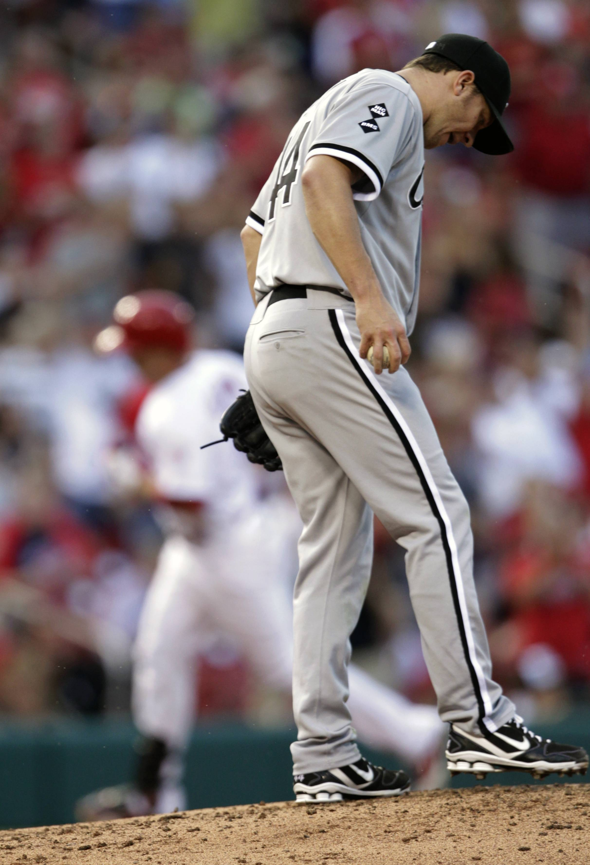 White Sox starting pitcher Jake Peavy kicks at the mound Wednesday while Carlos Beltran circles the bases on a solo home run during the third inning in St. Louis.