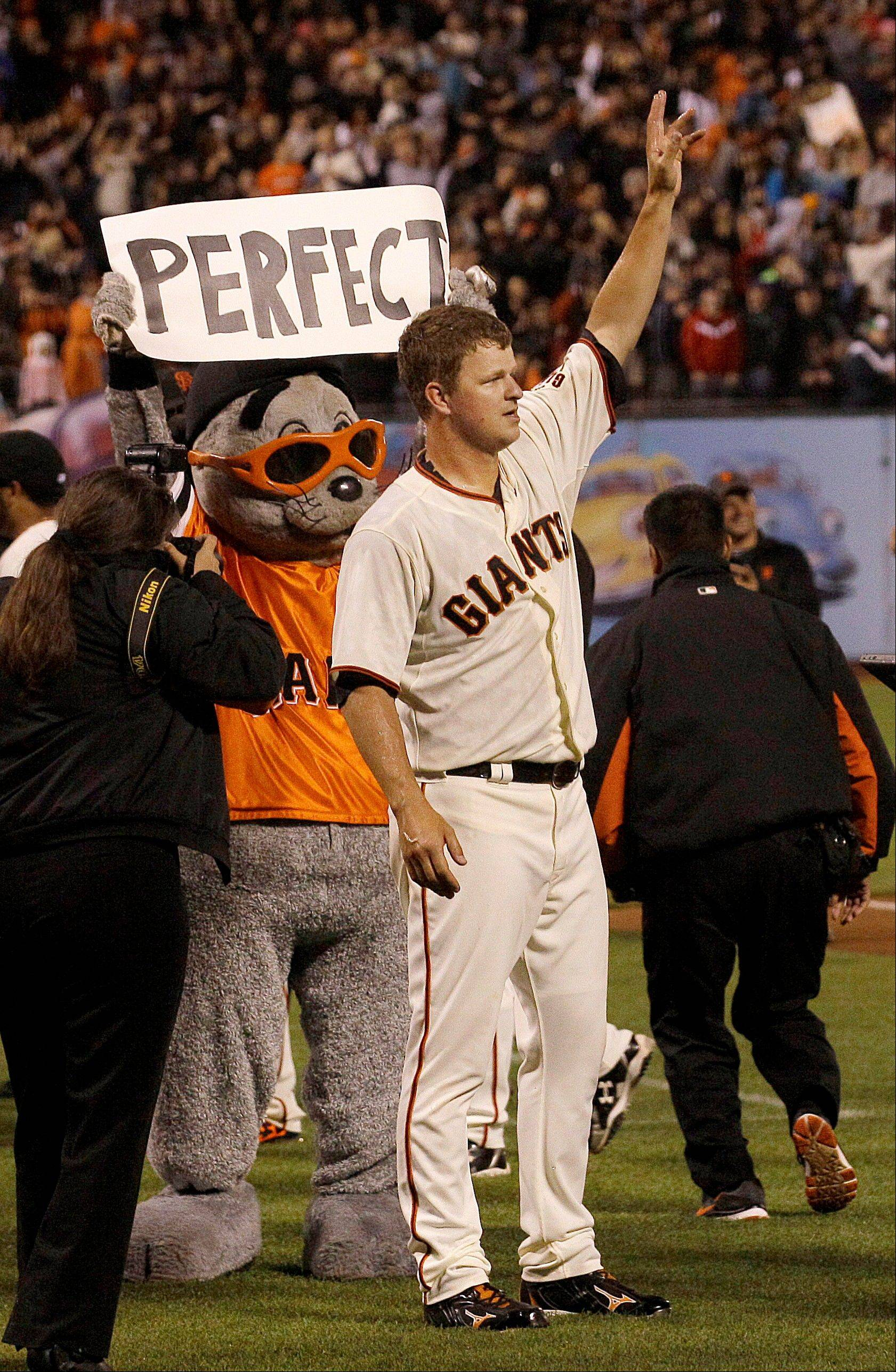 Giants pitcher Matt Cain celebrates after the final out of his perfact game against the Houston Astros on Wednesday in San Francisco.
