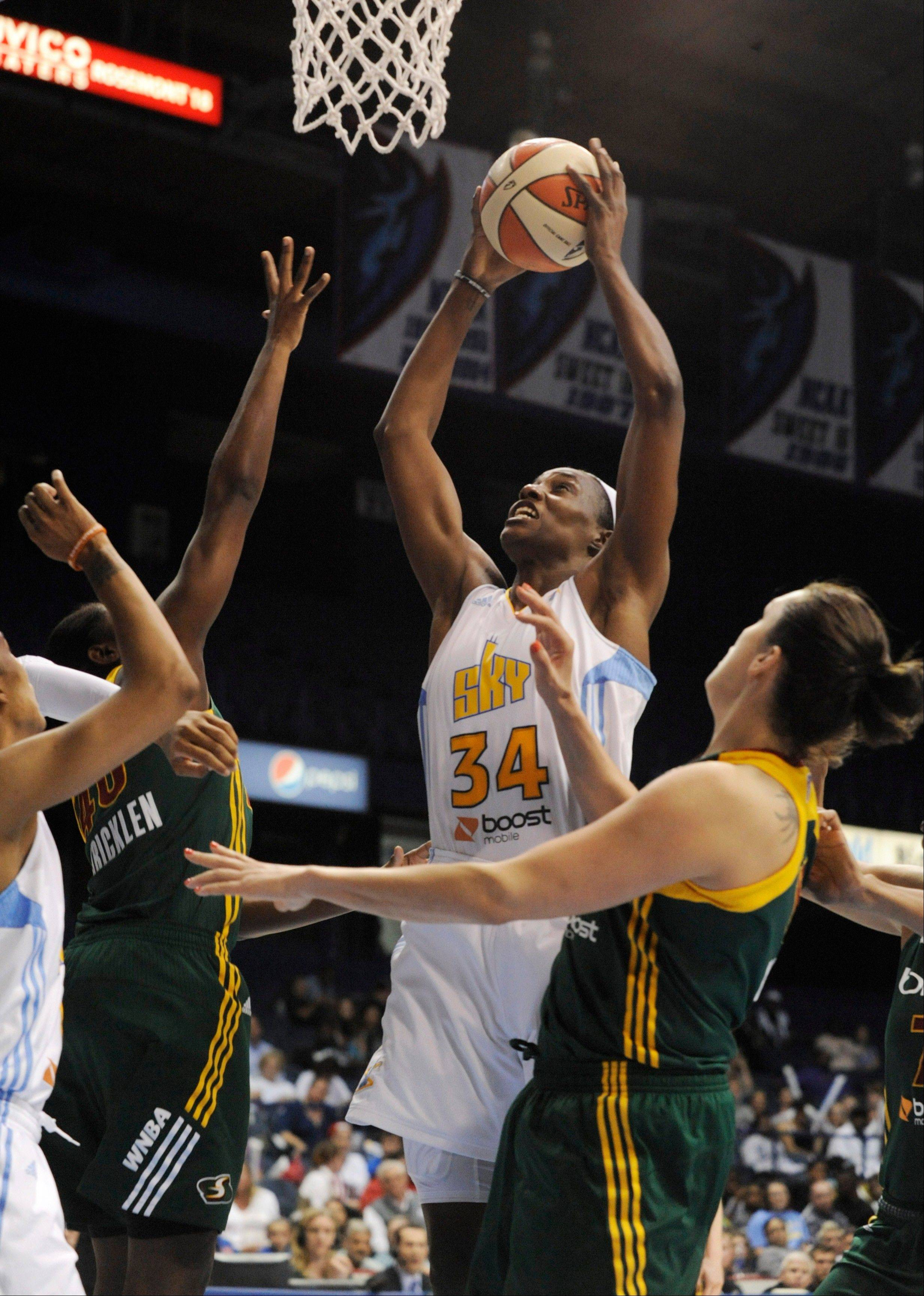The Sky's Sylvia Fowles goes up for a shot against the Seattle Storm's Shekinna Stricklen, left, and Ewelina Kobryn right, Wednesday during the fourth quarter at Allstate Arena. Chicago won 74-58.