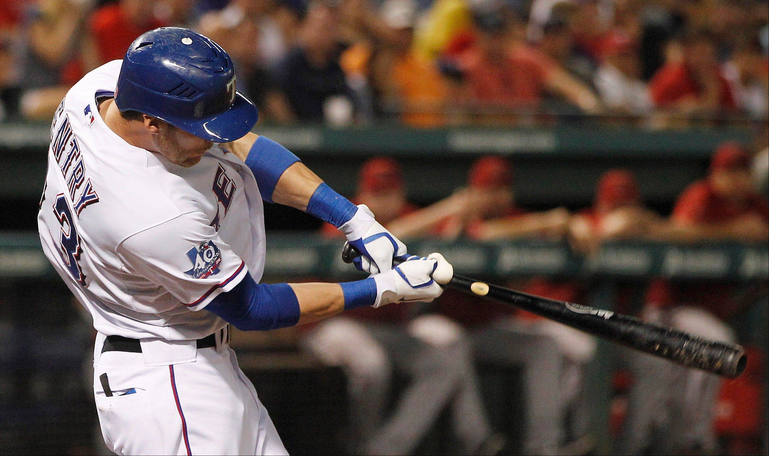 Texas Rangers Craig Gentry hits an RBI single Wednesday during the eighth inning against the Arizona Diamondbacks in Arlington, Texas. The Rangers won 1-0.
