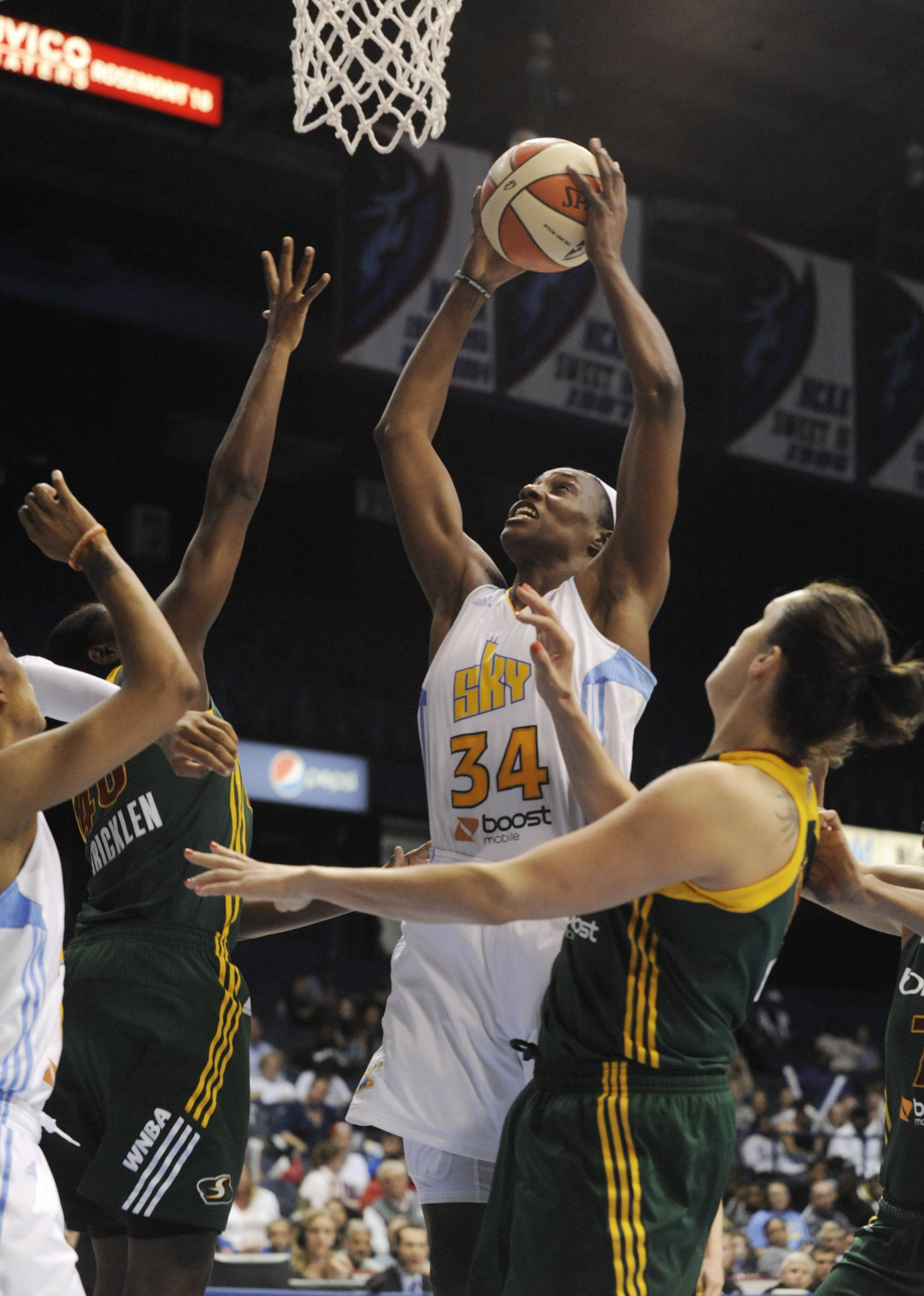 Sylvia Fowles goes up for a shot against the Seattle Storm's Shekinna Stricklen, left, and Ewelina Kobryn right, Wednesday during the fourth quarter. Chicago won 74-58.