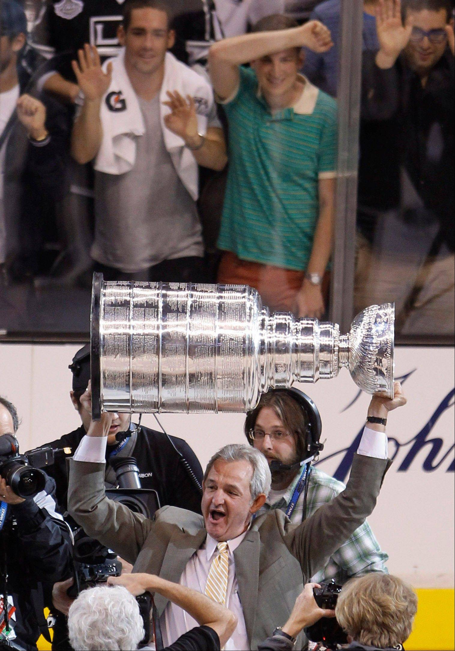 For Kings coach Darryl Sutter, it was an emotional night Monday when he finally got to hoist the Stanley Cup as a champion.