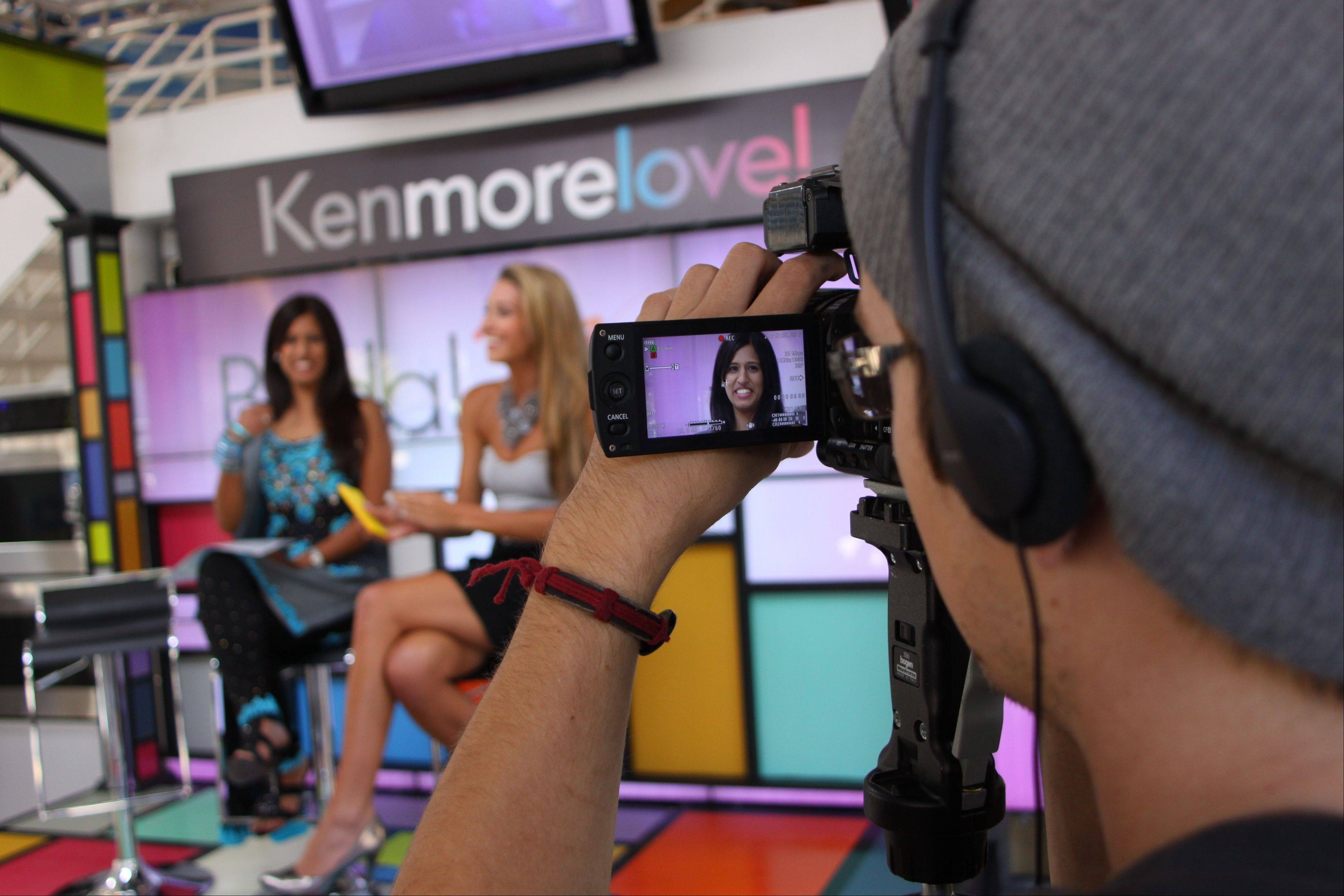 "A scene from last season's ""Bridal Wave"" show that streams on Facebook. Azure Nelson of Onewed.com, at right, talks with a bride in the Kenmore studio in Chicago."