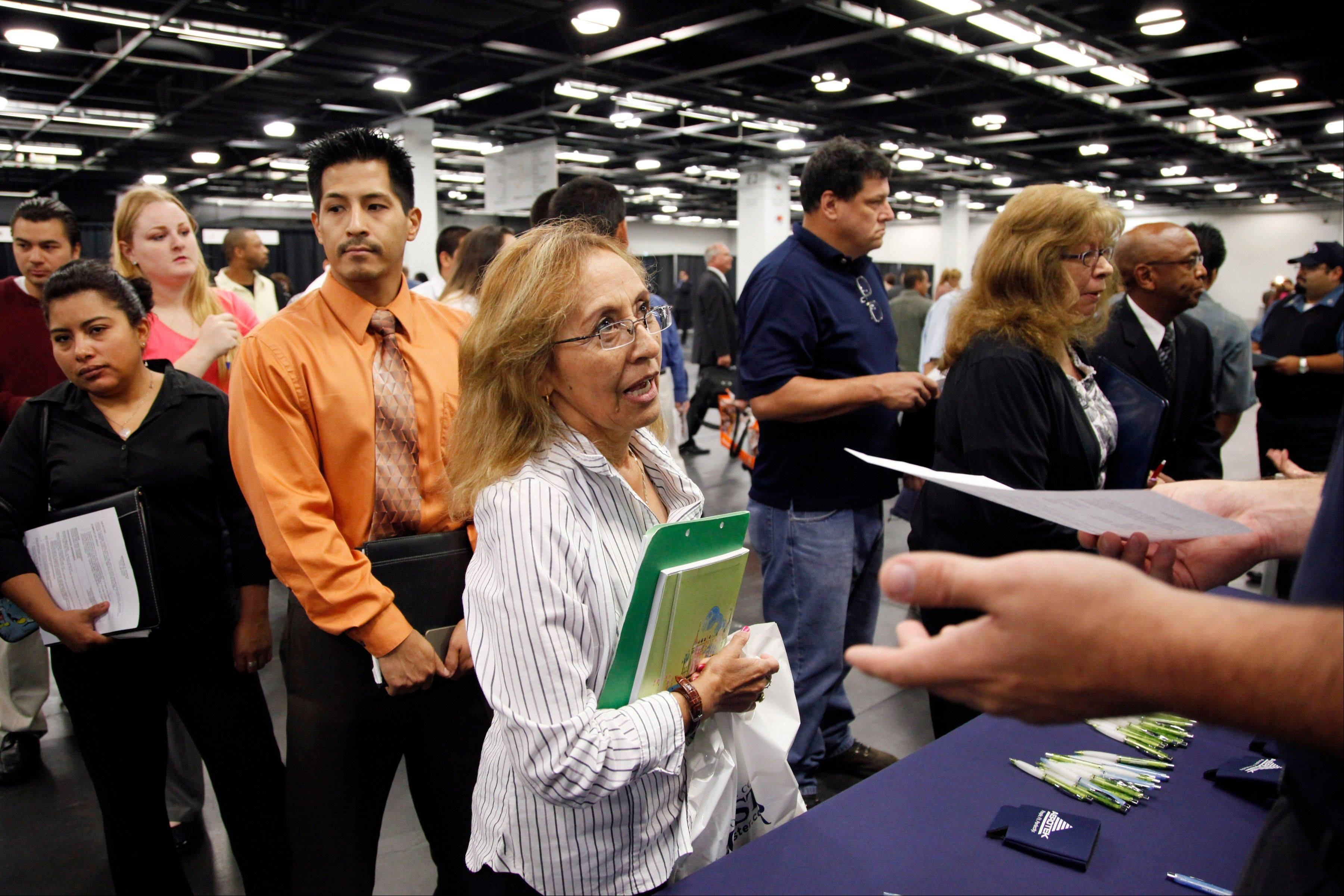 Maria Wilt, center, talks to a recruiter at a job fair expo in Anaheim, Calif.