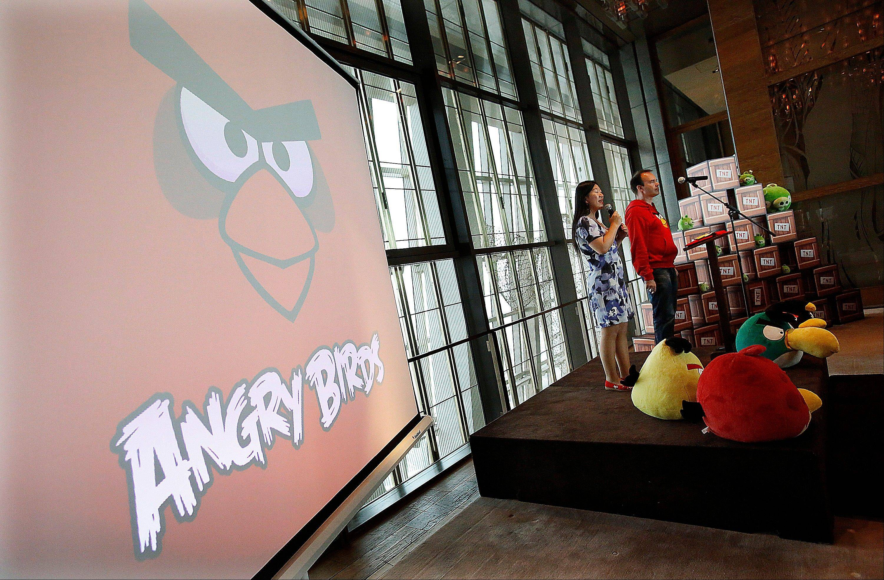 "Peter Vesterbacka, Mighty Eagle, Chief Marketing Officer, right, delivers a speech during the opening ceremony of the Shanghai office of Rovio, maker of popular game ""Angry Birds"", Thursday."