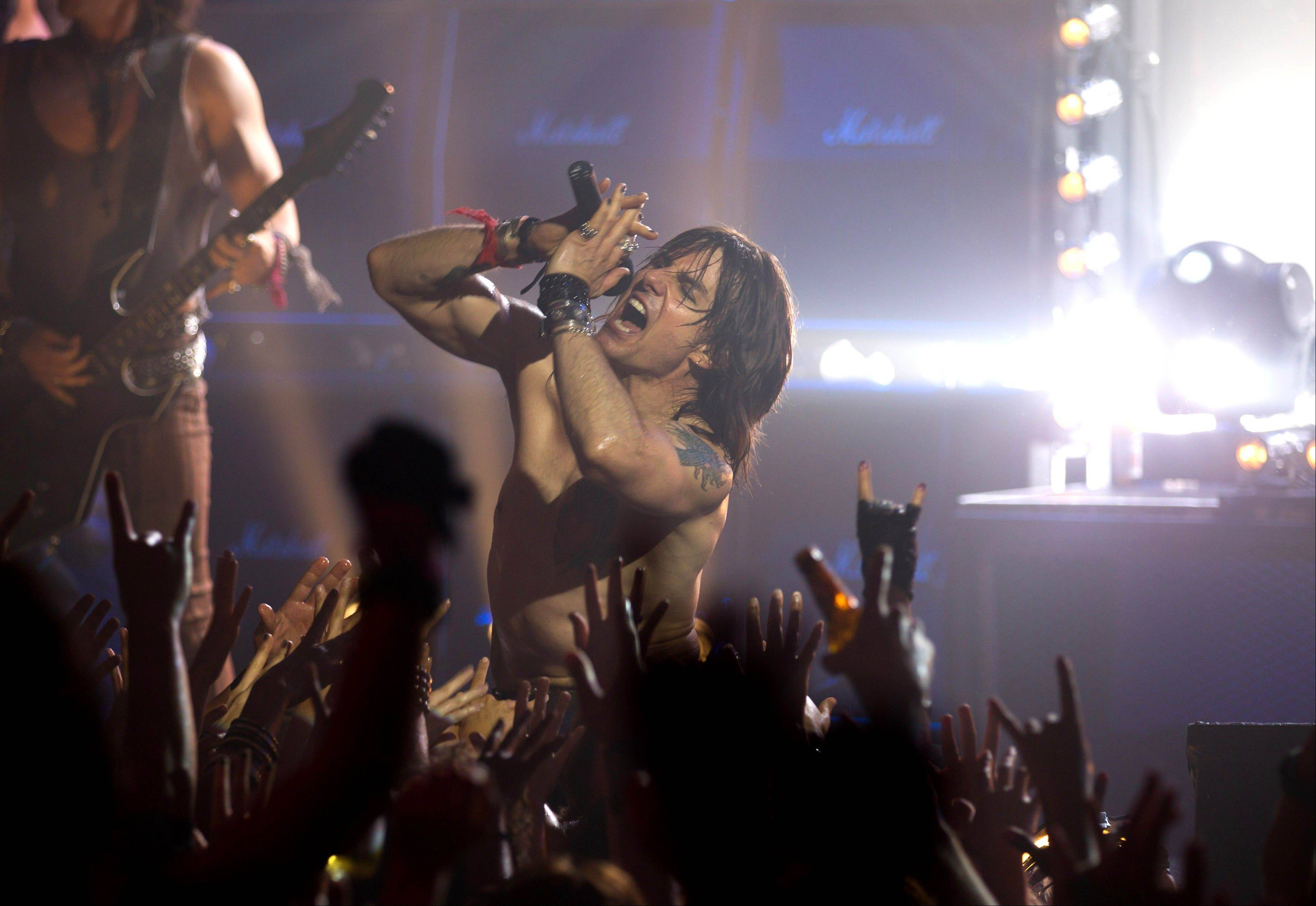 "Superstar Stacee Jaxx (Tom Cruise) hits the notes out of the auditorium in the rock musical ""Rock of Ages."""