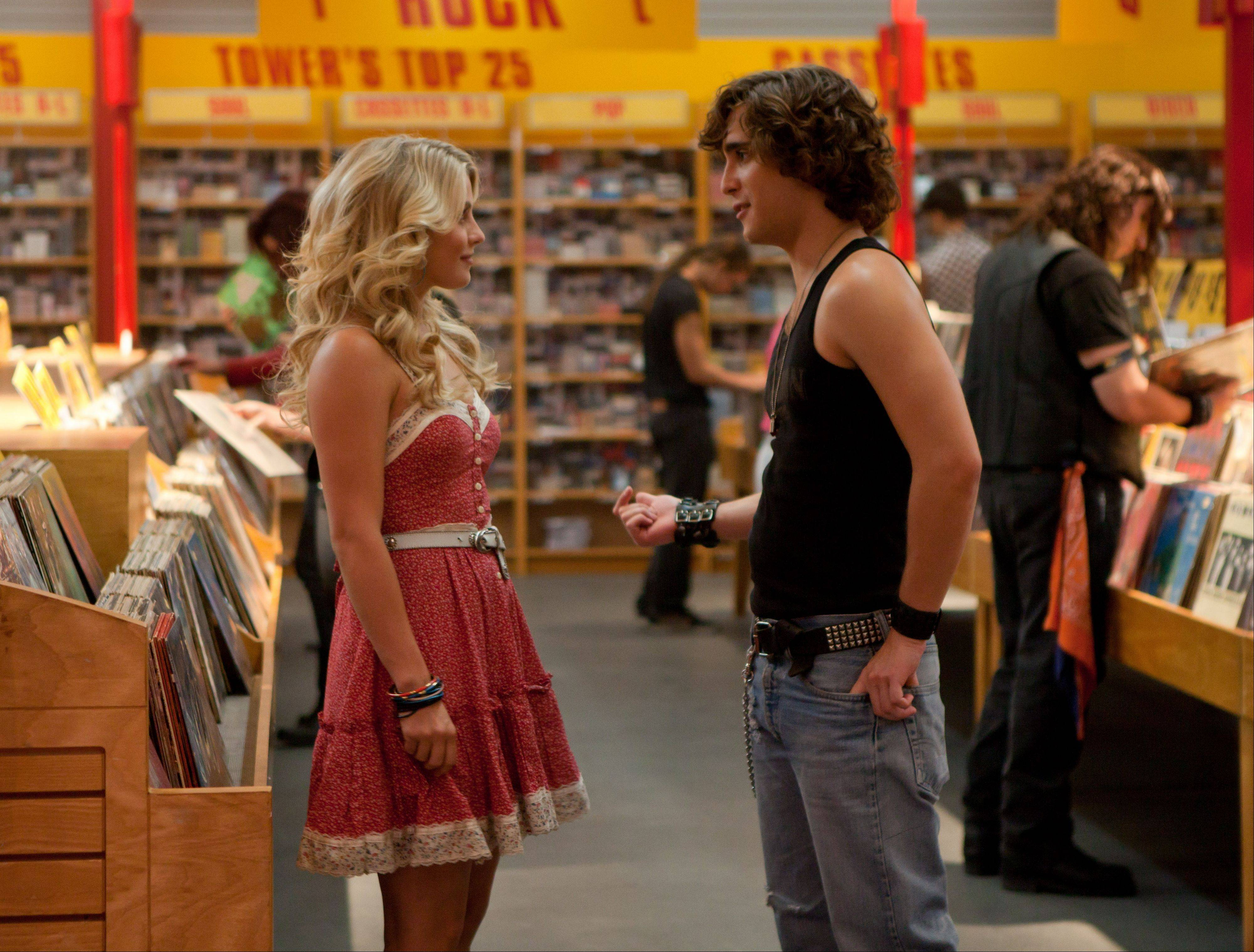 "Sherrie (Julianne Hough) and Drew (Diego Boneta) fall in love in L.A. in ""Rock of Ages."""