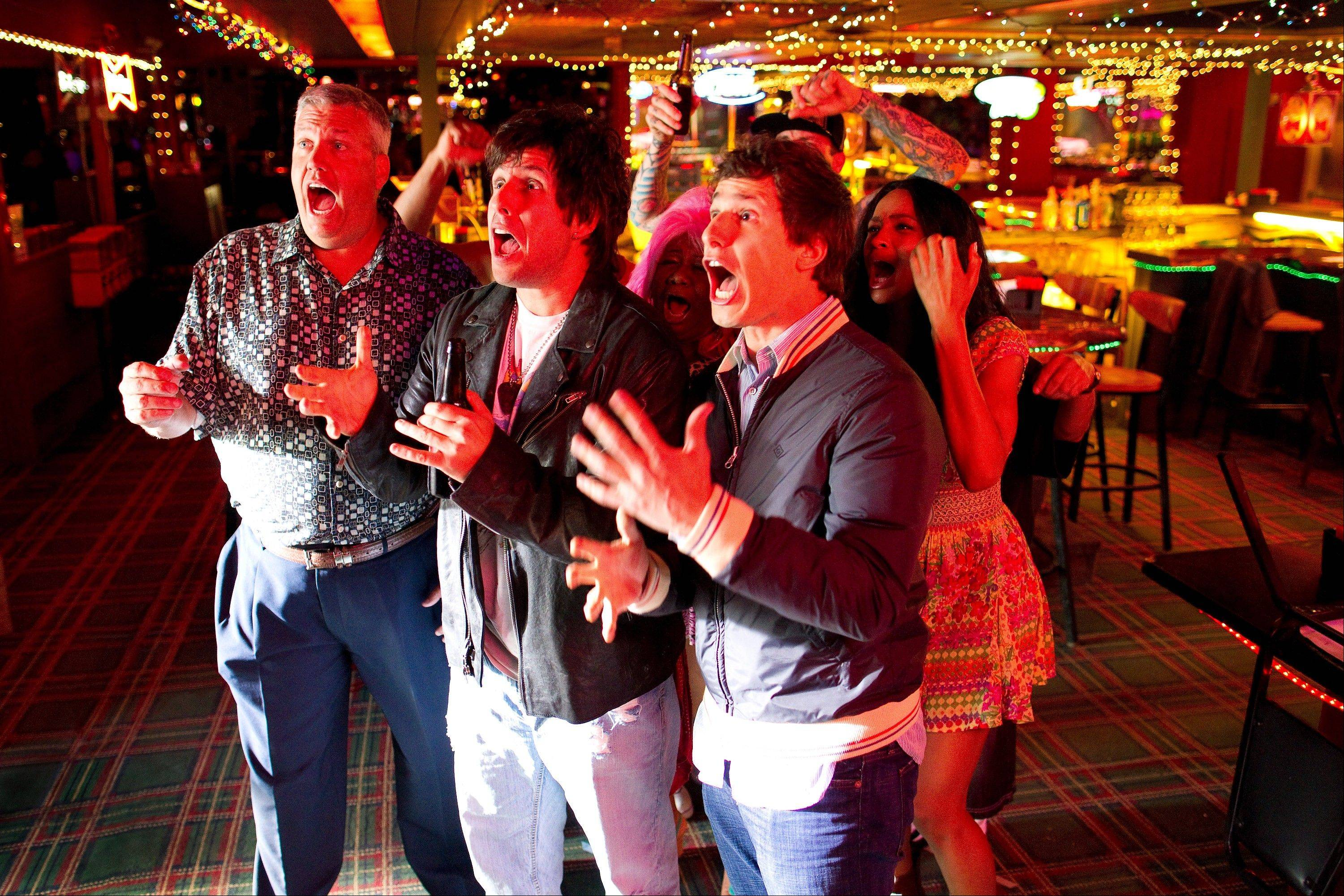 "Donny Berger (Adam Sandler), center, and his son Han Solo Berger (Andy Samberg) cheer on a televised marathon in the comedy ""That's My Boy."""