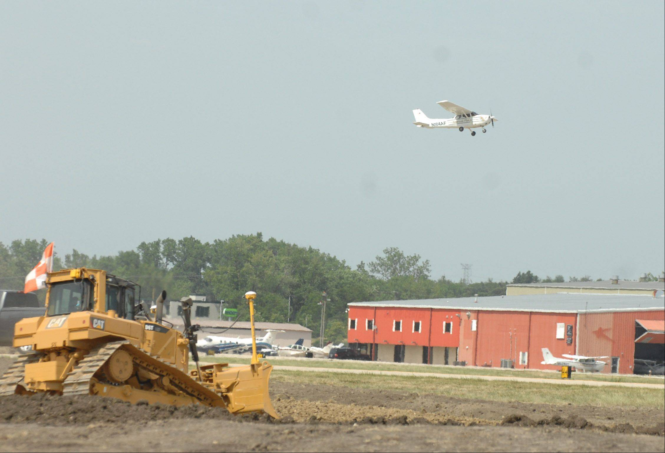 DuPage Airport officials hope the $3.5 million extension of the secondary runway will be complete by fall.