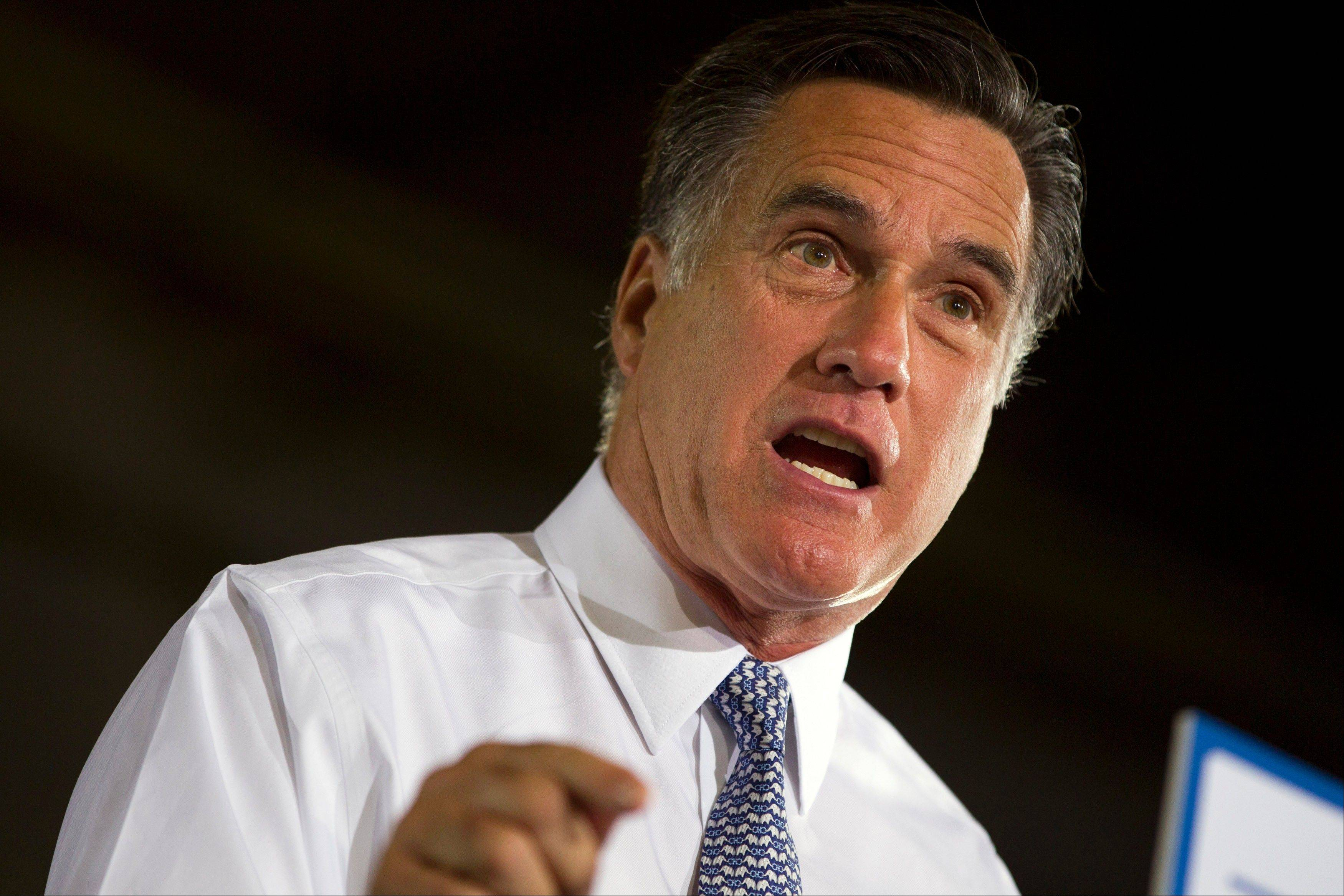 Republican presidential candidate, former Massachusetts Gov. Mitt Romney gestures during a campaign stop at Con-Air Industries, Tuesday, June 12, 2012, in Orlando, Fla.