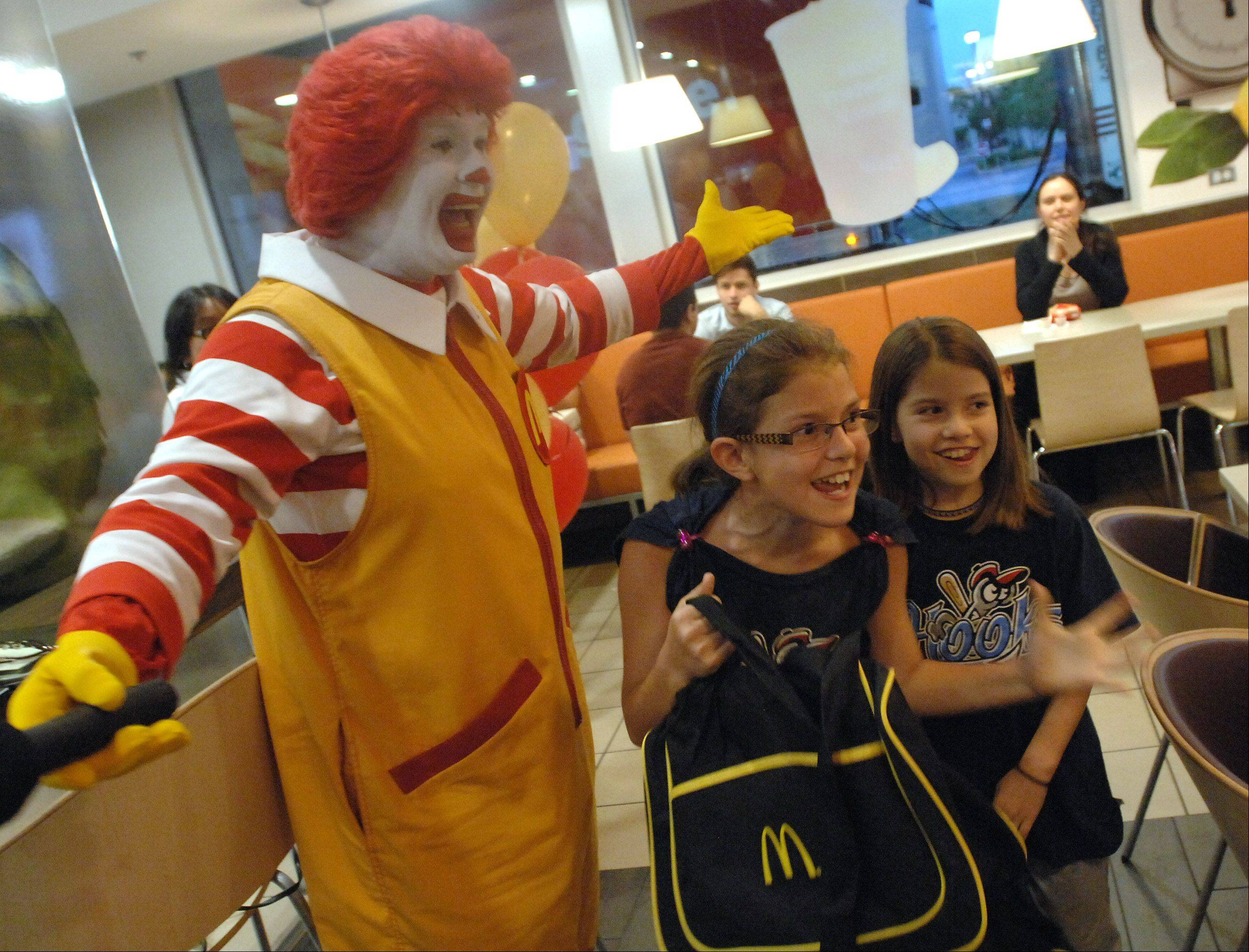 Katie, 8, and Liz O'Brien, 10, of Addison, react to the news they won a trip to the 2012 Olympic Games in London. The sisters took part in the McDonald's Happy Meal Chefs contest, for which they submitted a video demonstrating how they make mealtime fun and healthy.