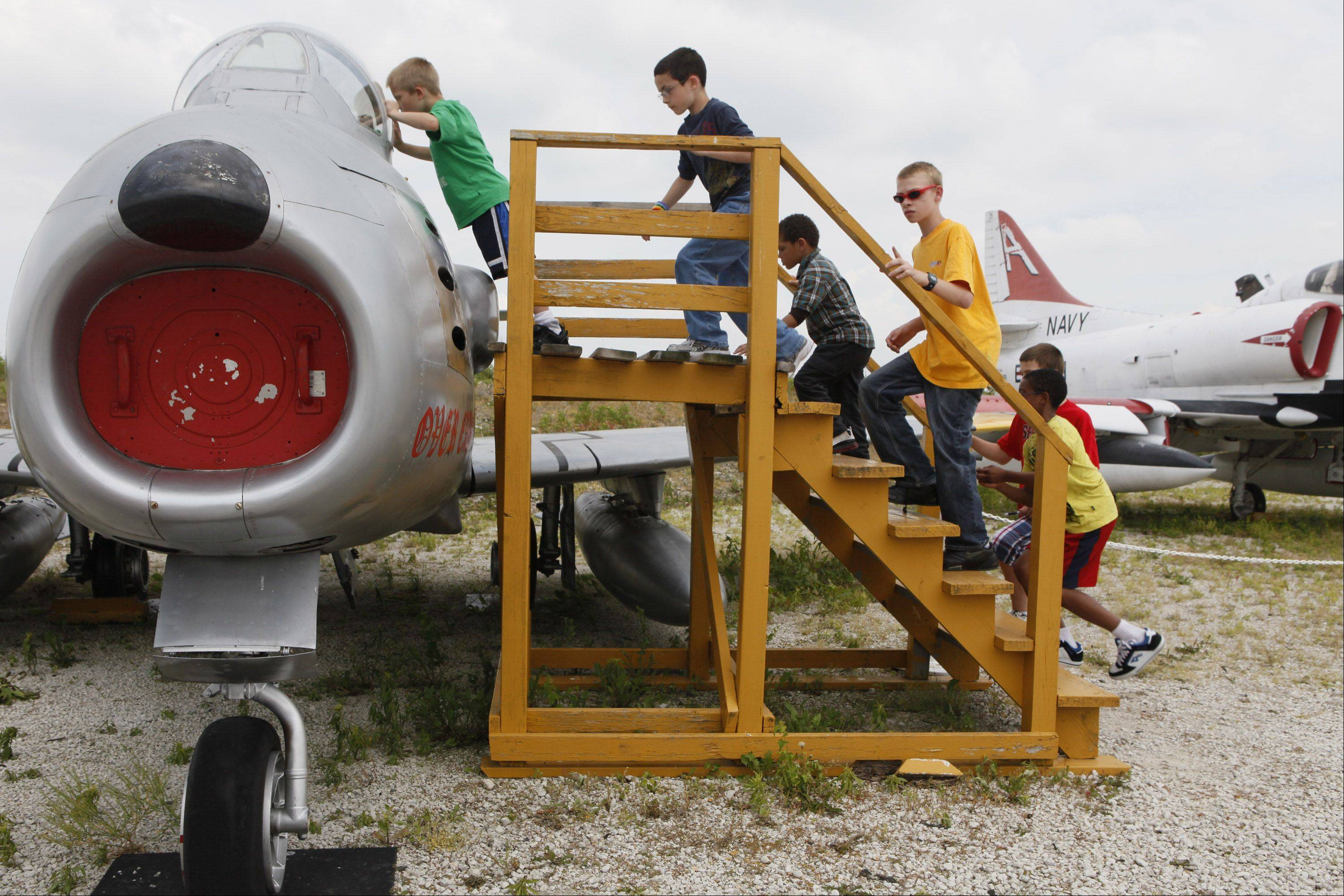 Air Classics Museum visitors look inside the cockpit of a fighter jet at last year's open house in Sugar Grove.