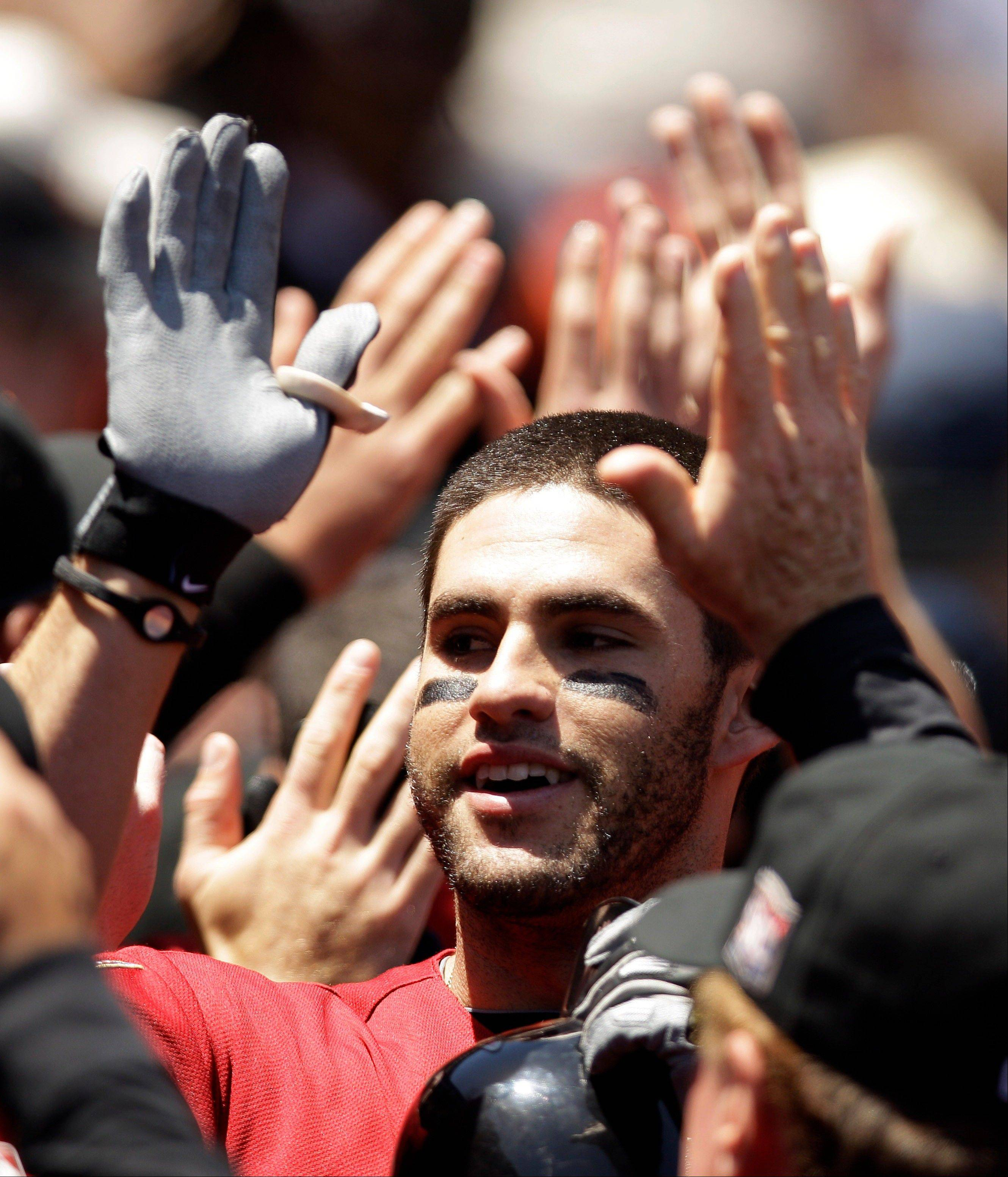 Houston's J.D. Martinez is high-fived in the dugout after his grand slam off Giants starting pitcher Barry Zito during the third inning Thursday in San Francisco.