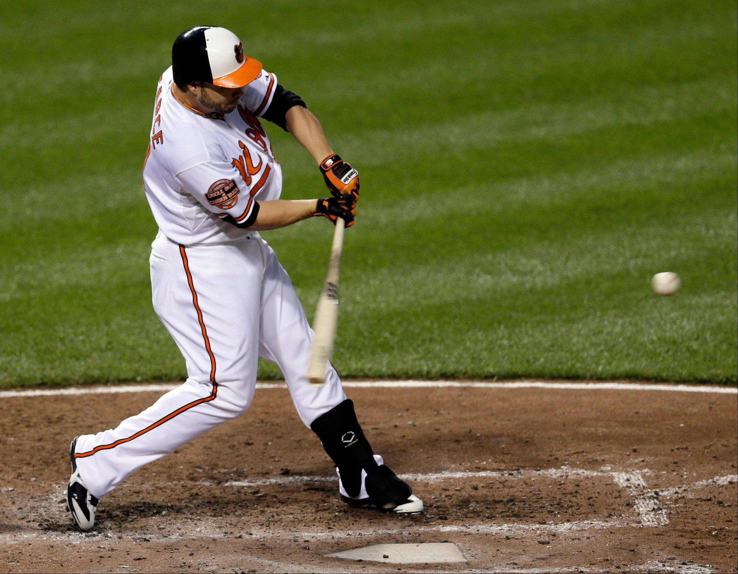 The Orioles' Steve Pearce hits a three-run home run in the fourth inning Thursday against the Pittsburgh Pirates in Baltimore.