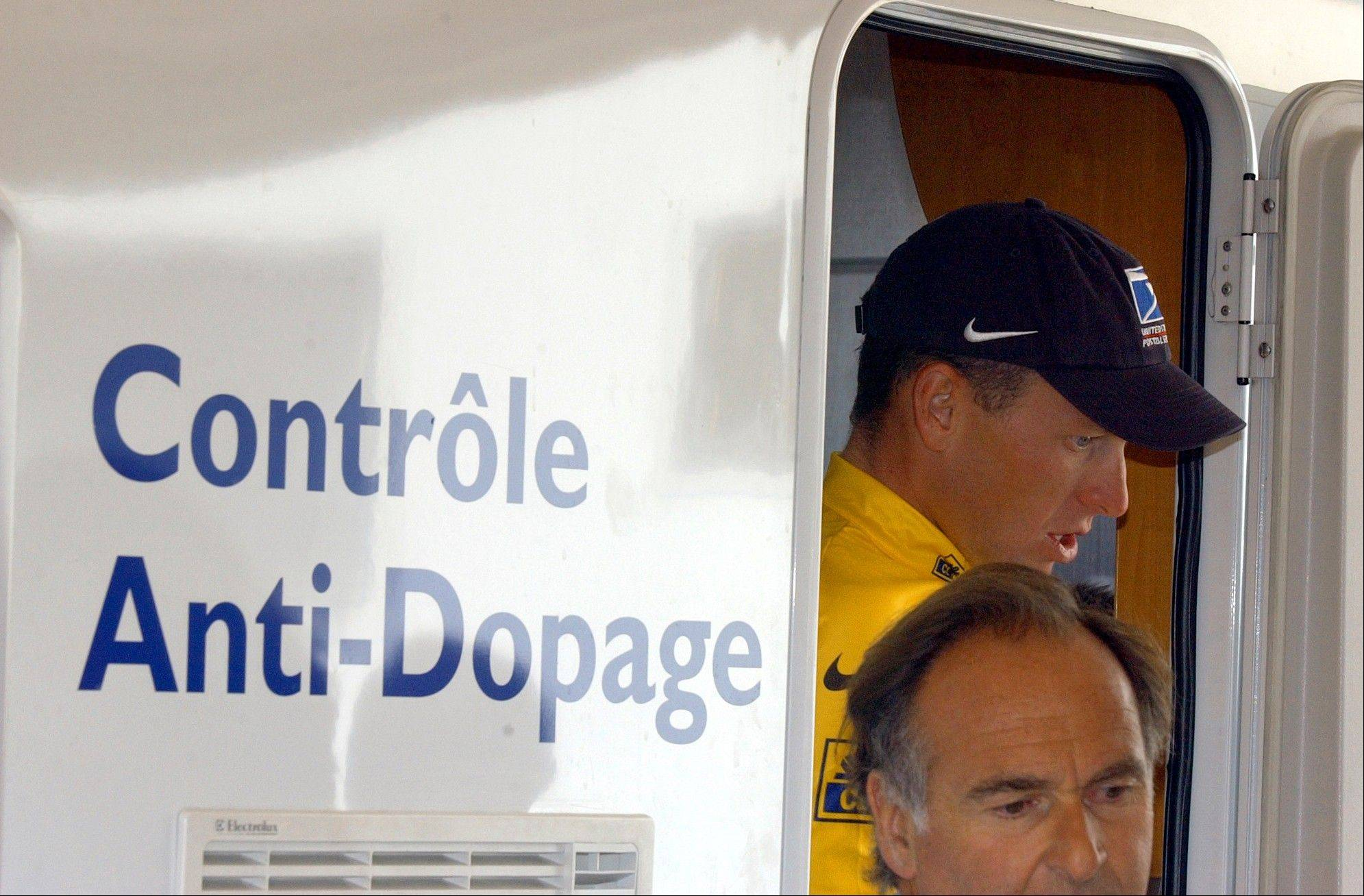 "Cyclist Lance Armstrong walks out of the Tour de France's anti-doping control bus after the 16th stage of the Tour de France cycling race between Les Deux Alpes and La Plagne. The U.S. Anti-Doping Agency is bringing doping charges against the seven-time Tour de France winner, questioning how he achieved those famous cycling victories. Armstrong, who retired from cycling last year, could face a lifetime ban from the sport if he is found to have used performance-enhancing drugs. He maintained his innocence, saying: ""I have never doped."""