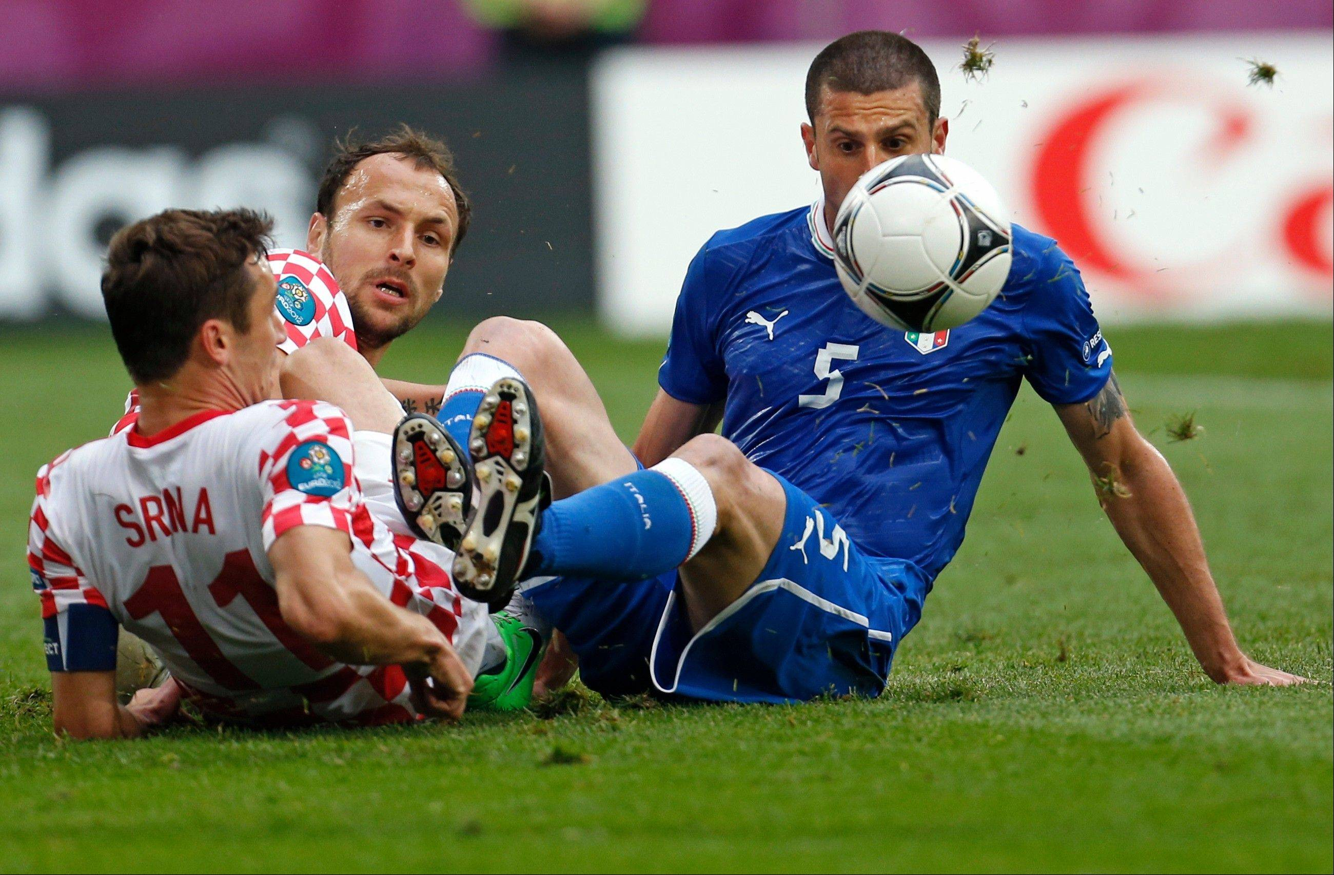 Italy's Thiago Motta, right, and Croatia's Darijo Srna challenge for the ball Thursday during the Euro 2012 Group C match in Poznan, Poland.