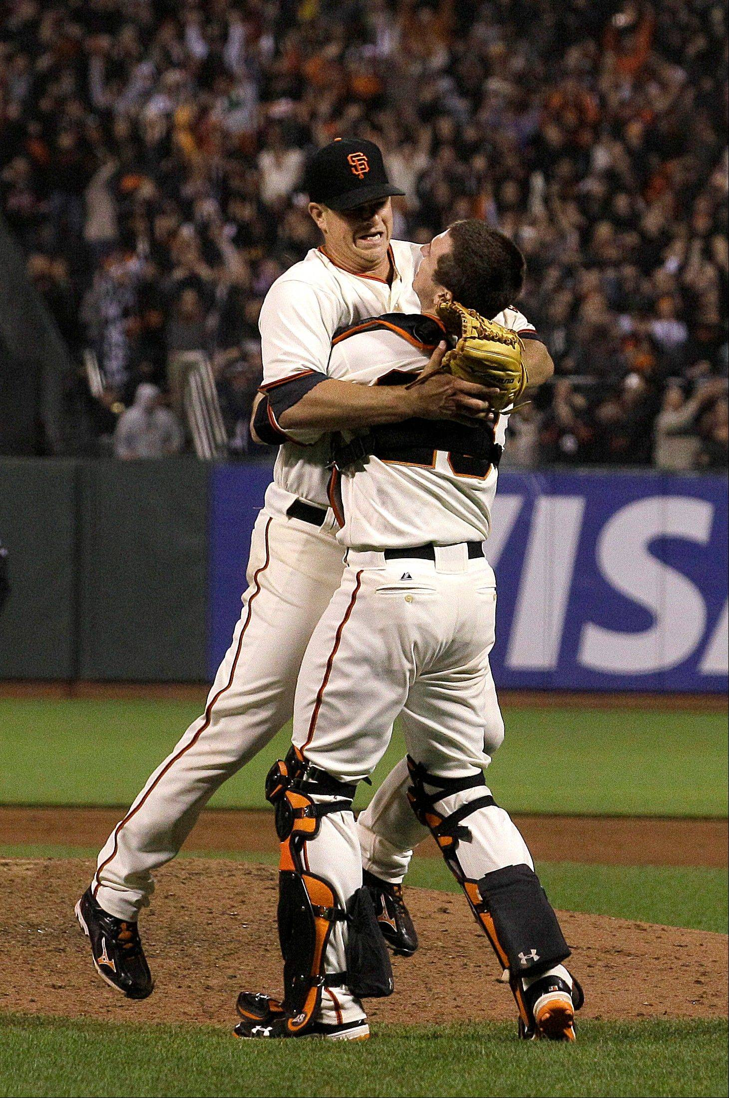 San Francisco Giants pitcher Matt Cain, left, celebrates Wednesday with catcher Buster Posey after the final out against the Houston Astros in San Francisco.
