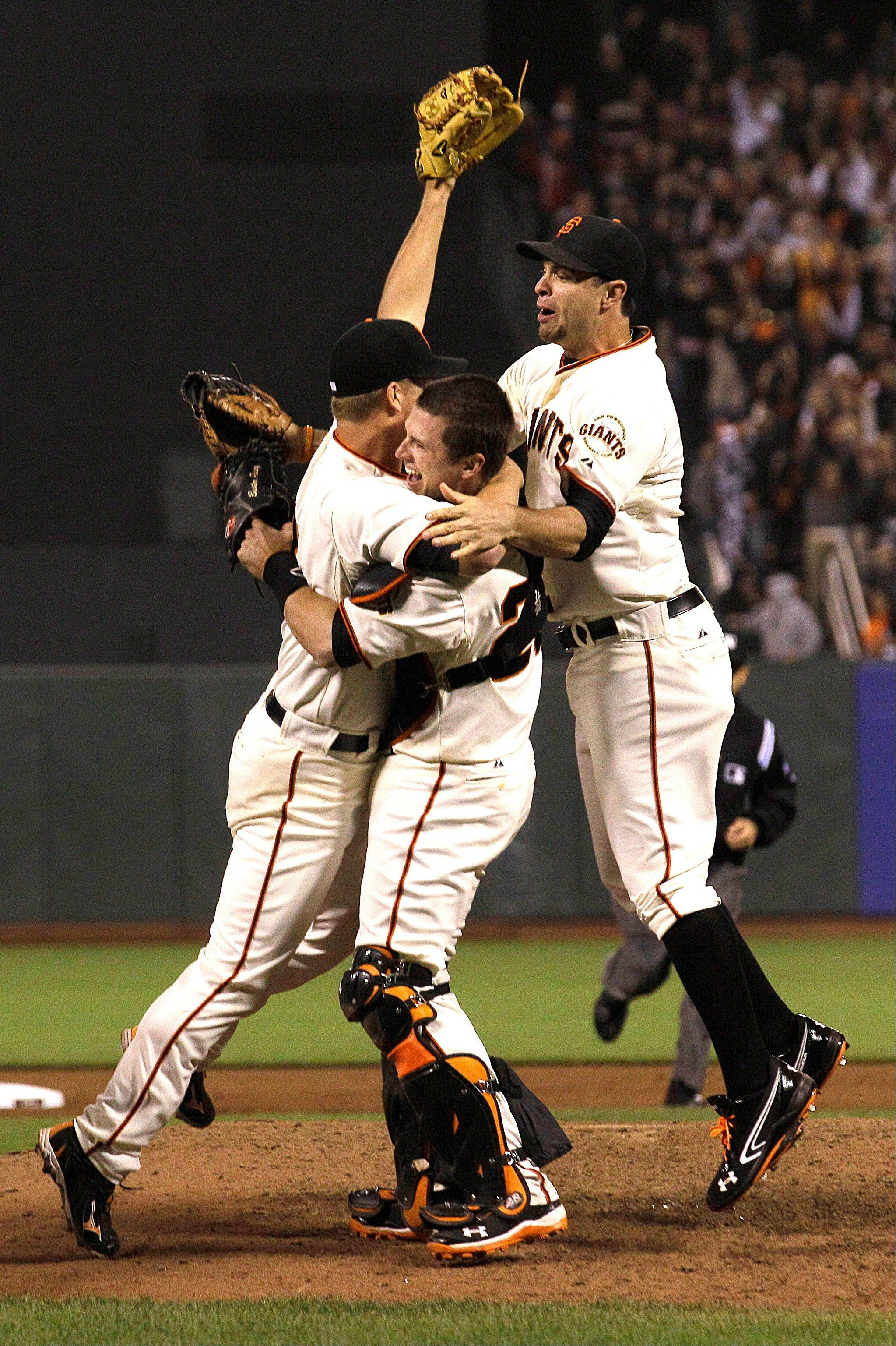 San Francisco Giants pitcher Matt Cain, left, celebrates Wednesday with catcher Buster Posey, center, and first baseman Brandon Belt after the final out against the Houston Astros in San Francisco.